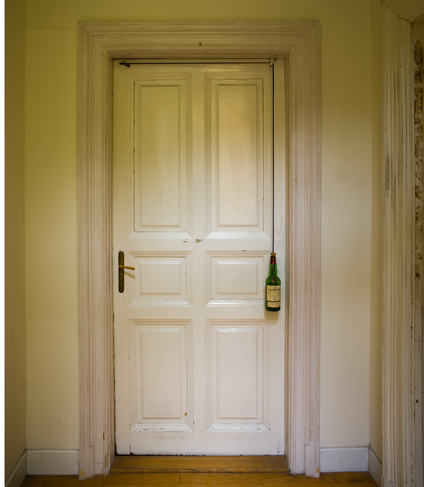 Brody House door closes with a whiskey bottle on a pulley