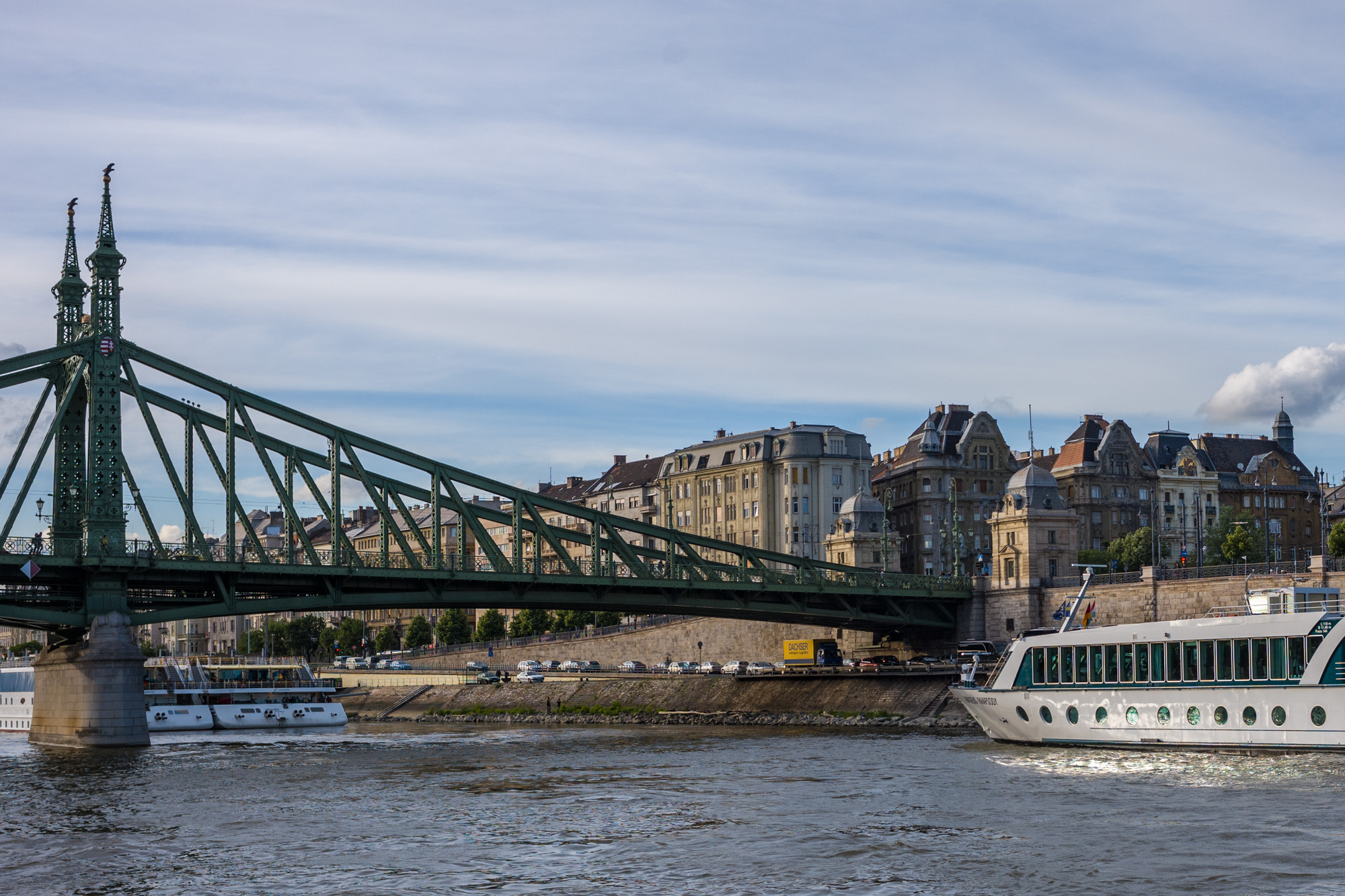 Cruising under a bridge floating on the Blue Danube