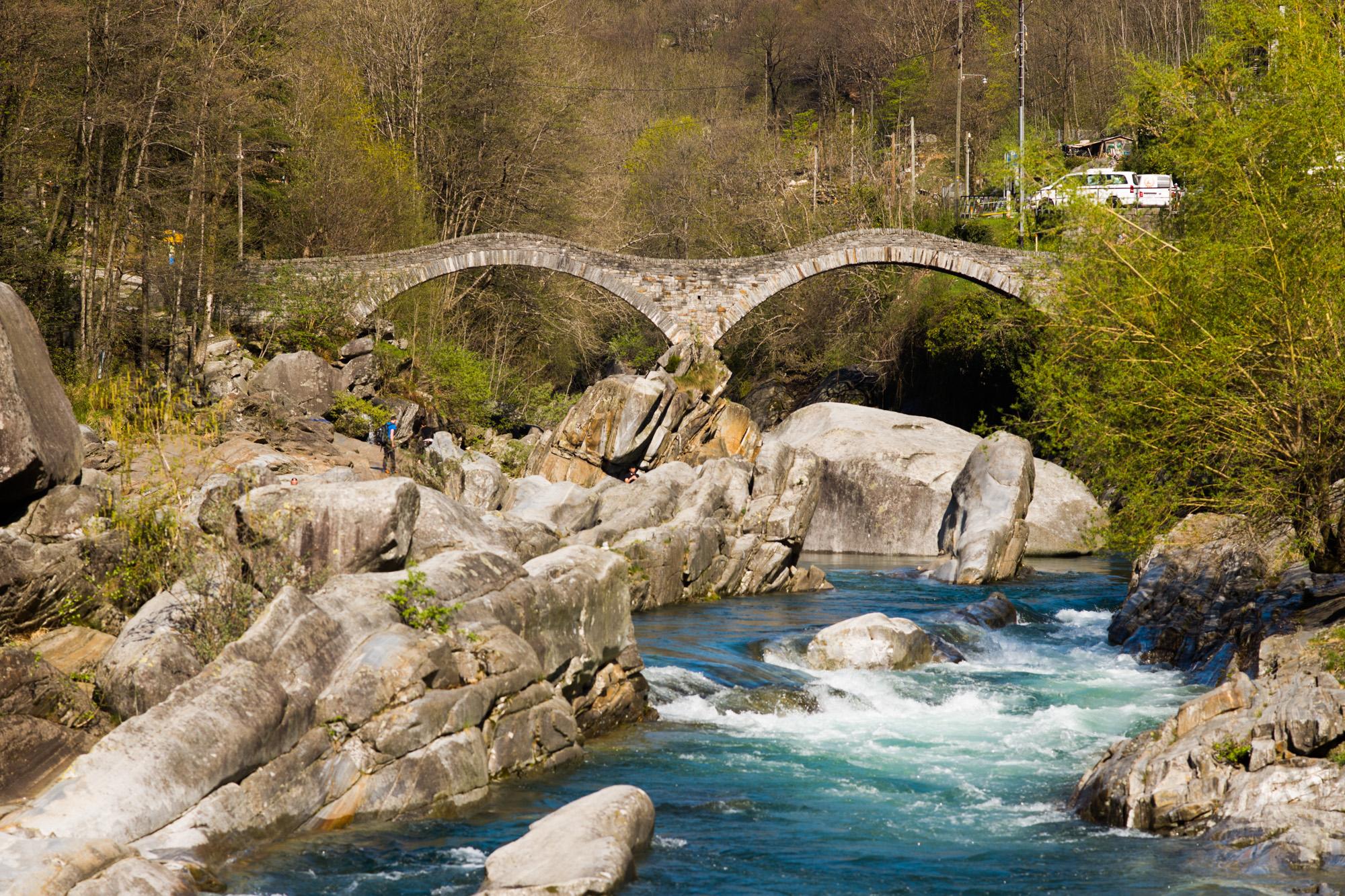 The 400 year old Ponte dei Salti stone bridge over the green Verzasca River