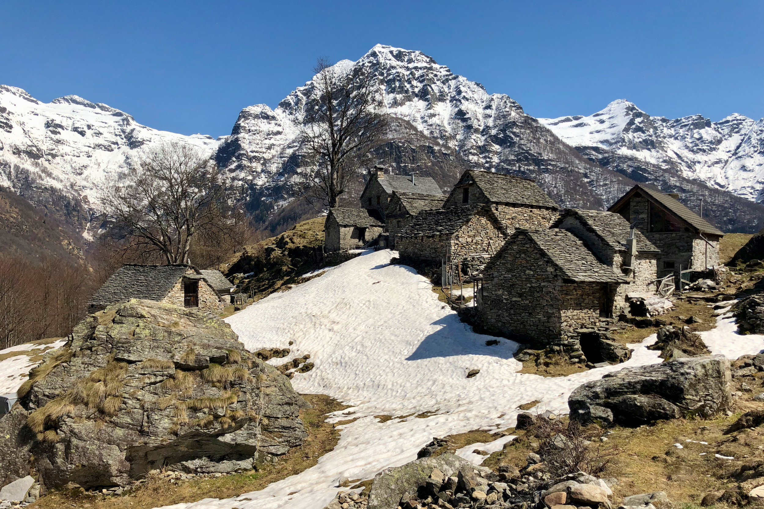 A small village of stone buildings high in the Lepontine Alps