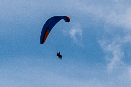 Q2, 28mm Summilux, cropped very tightly, 450x300 pixels. Notice you can see the ropes of the glider
