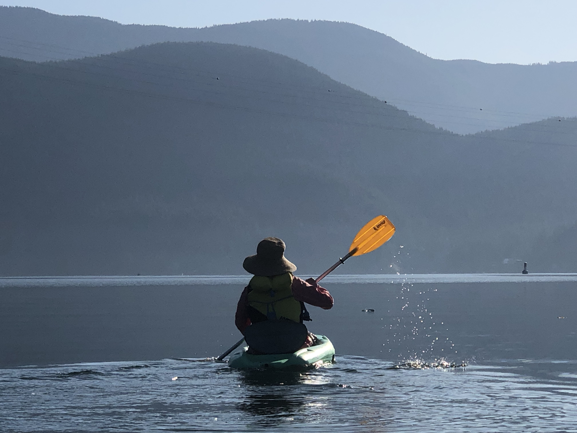 Pre-breakfast kayak on water as smooth as glass in Deep Cove