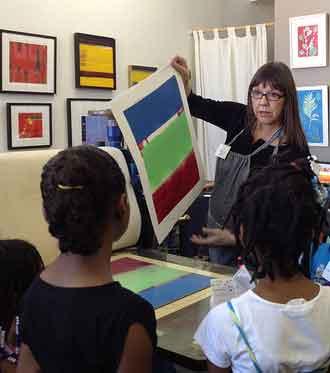 Shipyard artist Marc Ellen Hamel teaching printmaking