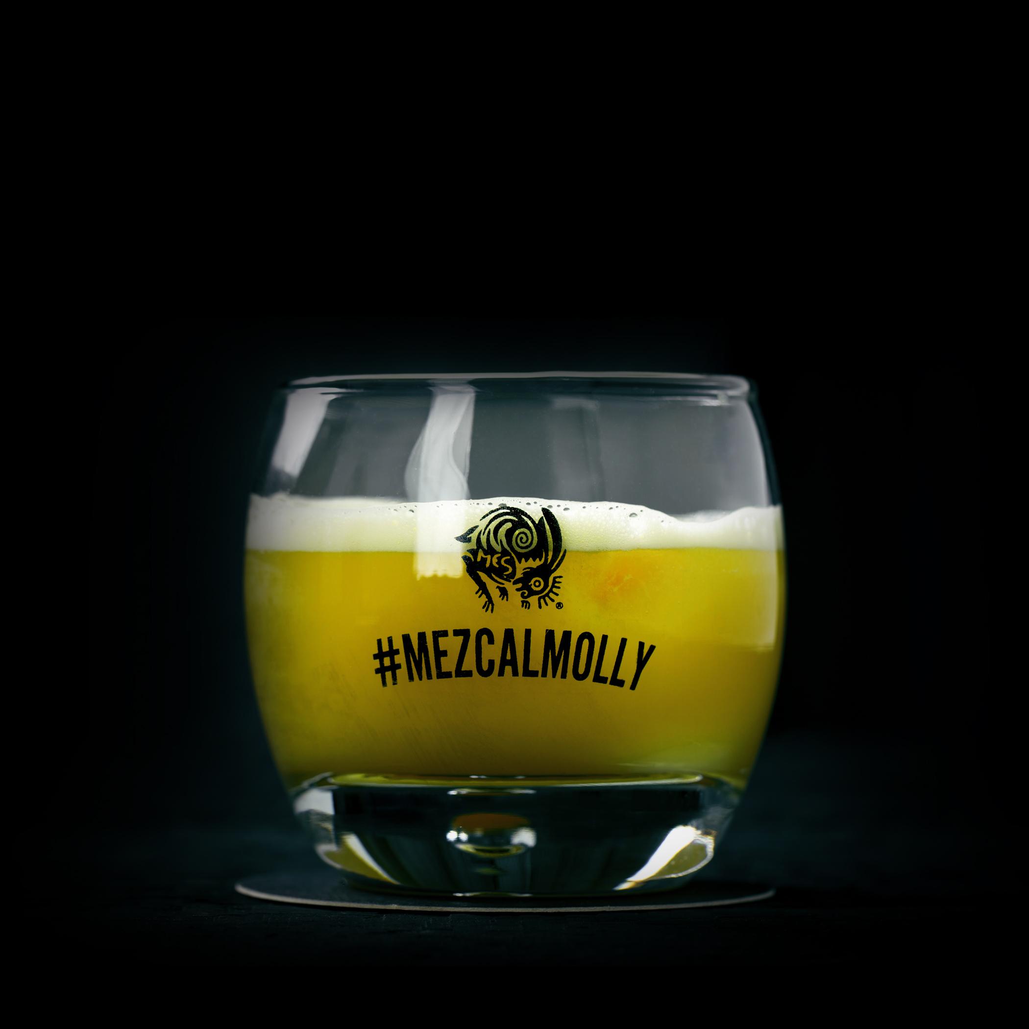 THE MEZCAL MOLLY  INGREDIENTS  - 2 oz. El Silencio Espadin  - .75 oz. Honey Syrup  - .75 oz. Fresh Lime Juice  METHOD  Shake & Strain  Pinch of Chile Salt