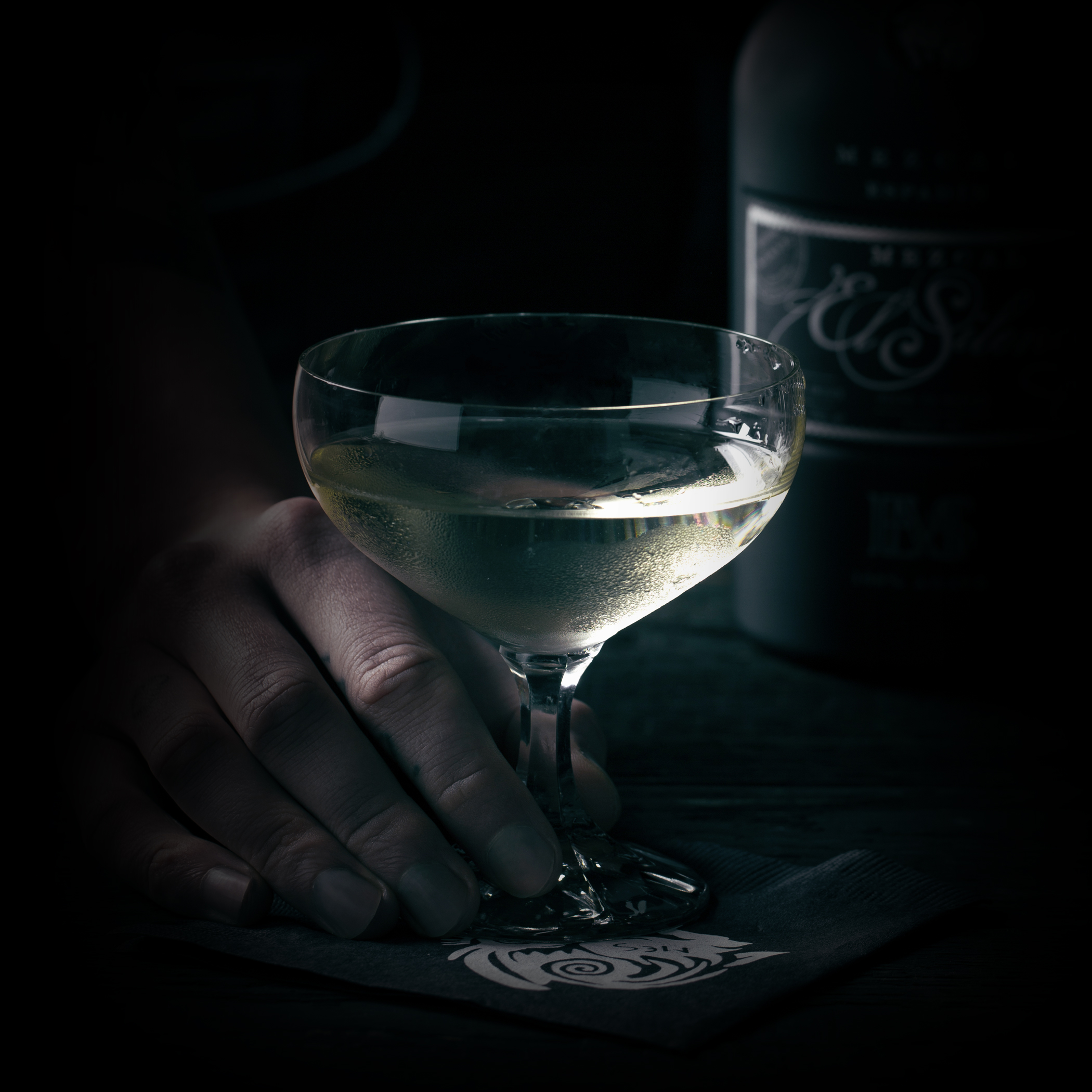 THE MEZCAL DIRTY MARTINI    INGREDIENTS  - .5 oz. El Silencio Espadin  - 2 oz. Vodka  - .5 oz. Castelvetrano Olive Juice  METHOD  Shake & Strain  Castelvetrano Olives - Cocktail Glass