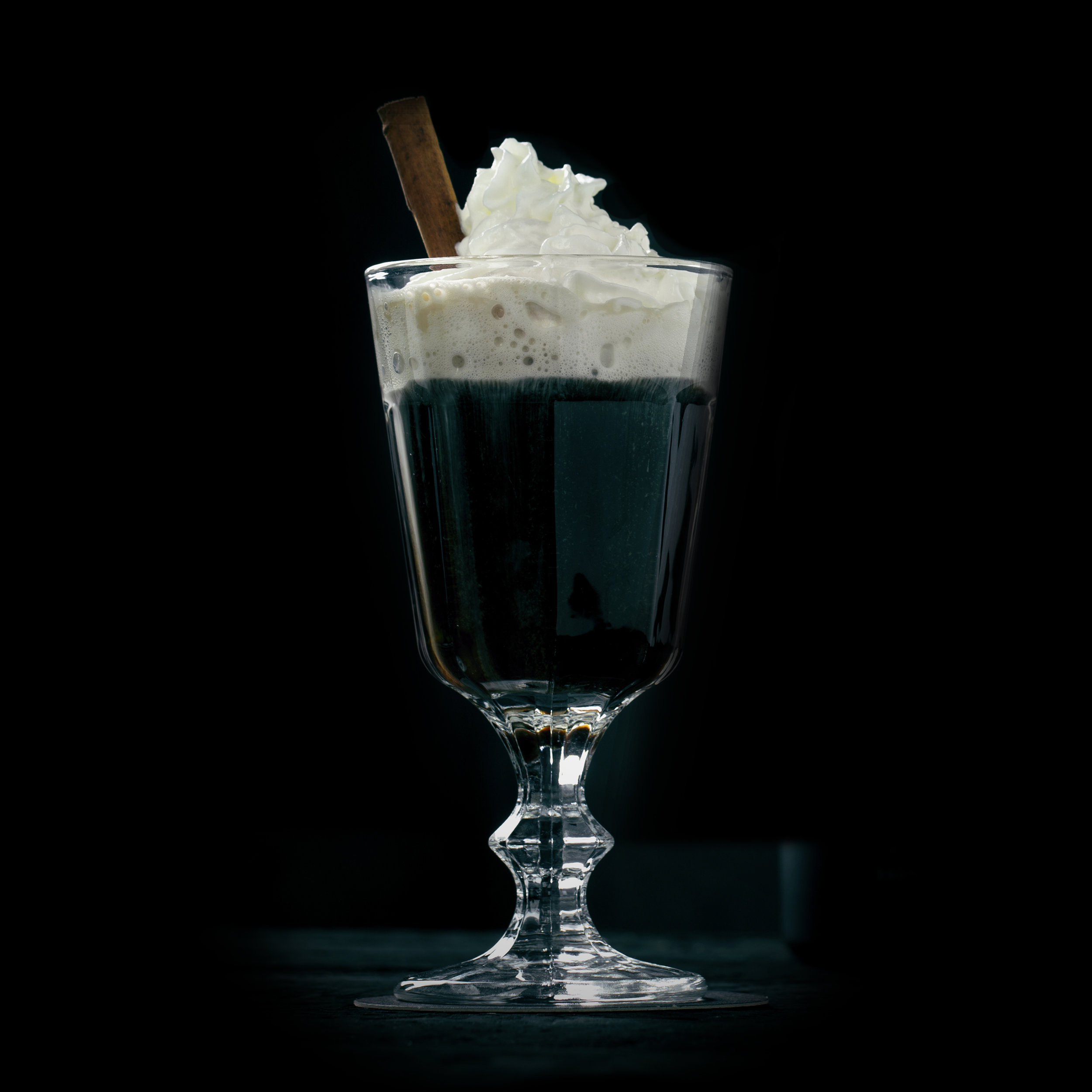 CAFE NOIR  INGREDIENTS  - 2 oz. El Silencio Espadin  - 1 oz. Galliano Ristretto  - 1 Double Shot Espresso (2 oz.)  METHOD  Stir with Cinnamon Stick & Vanilla Bean -Serve in a latte cup or your favorite coffee mug