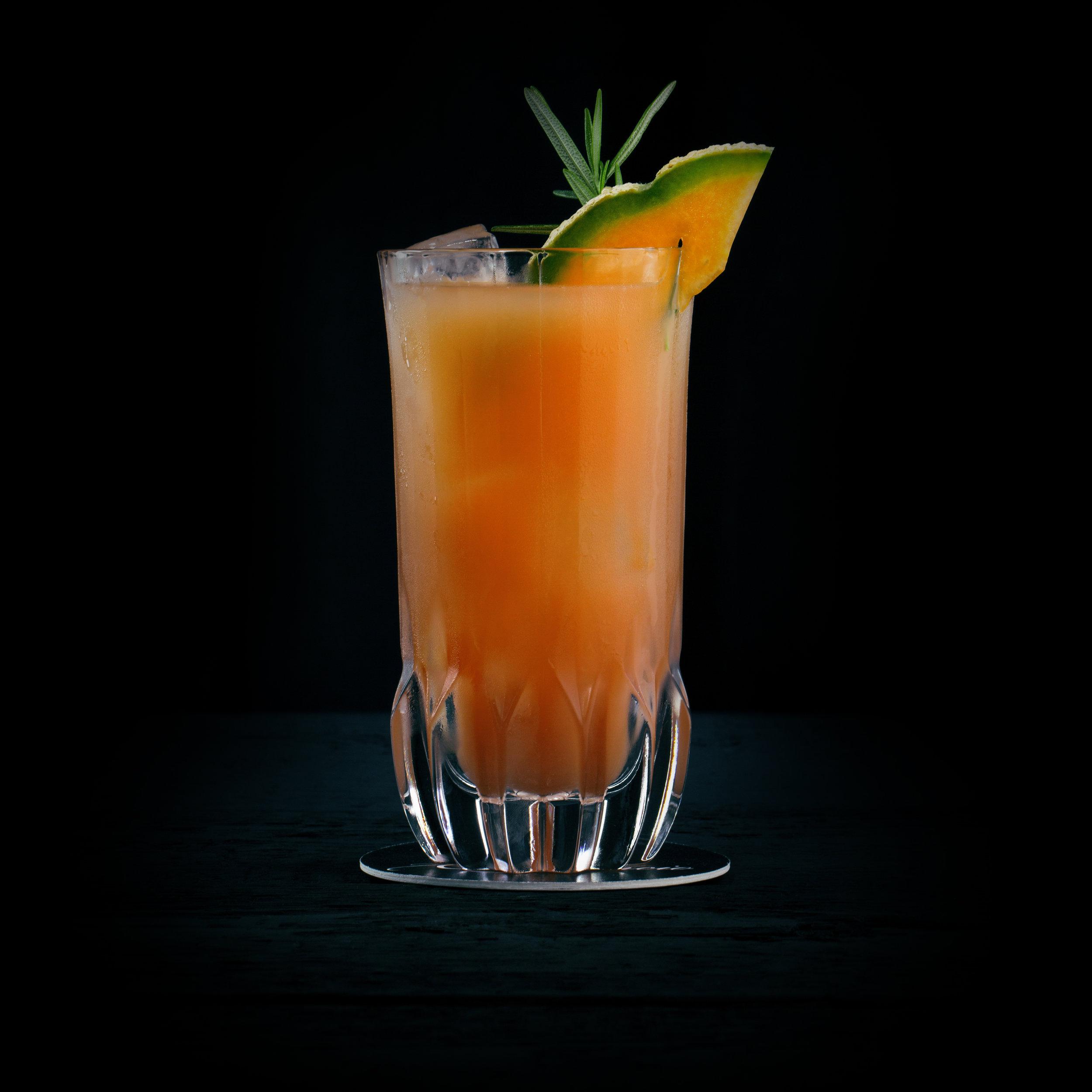 MEGAMELONIAC  INGREDIENTS  - 1.5 oz. El Silencio Espadin - 1 oz. Fresh Lime Juice - 3 oz Cantaloupe Melon Juice - .5 oz Simple Syrup - Dash Vanilla Bitters  METHOD  Shake with Ice & Strain Garnish: Melon and Thyme