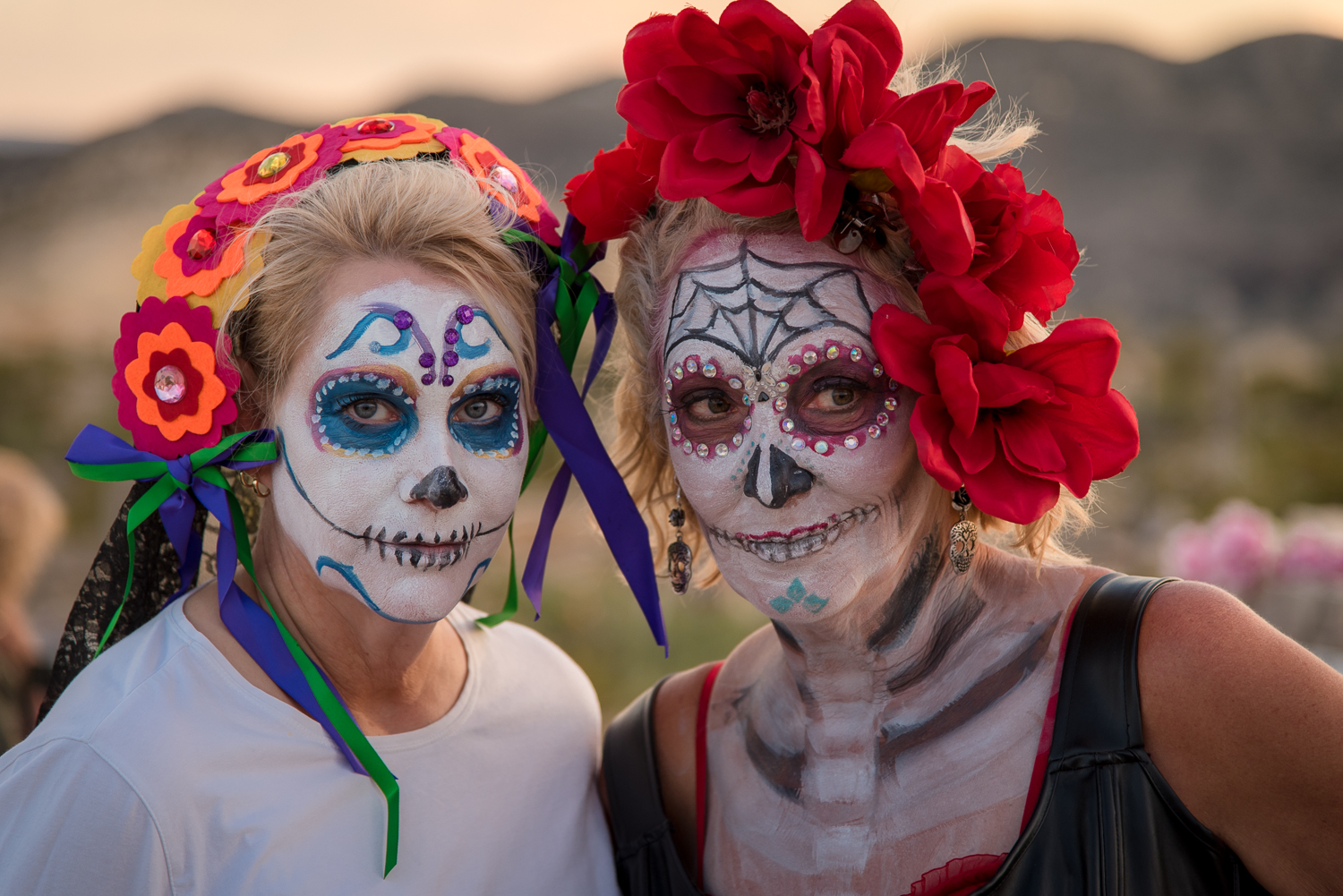 ©Ayash Basu. Day of the Dead celebrations in Terlingua, Texas. I took this image with the sun behind the women to get even light on their faces, avoiding unpleasant shadows.