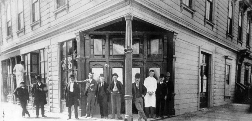 Men standing outside a Bryant Street saloon, Photo: SF Public Library
