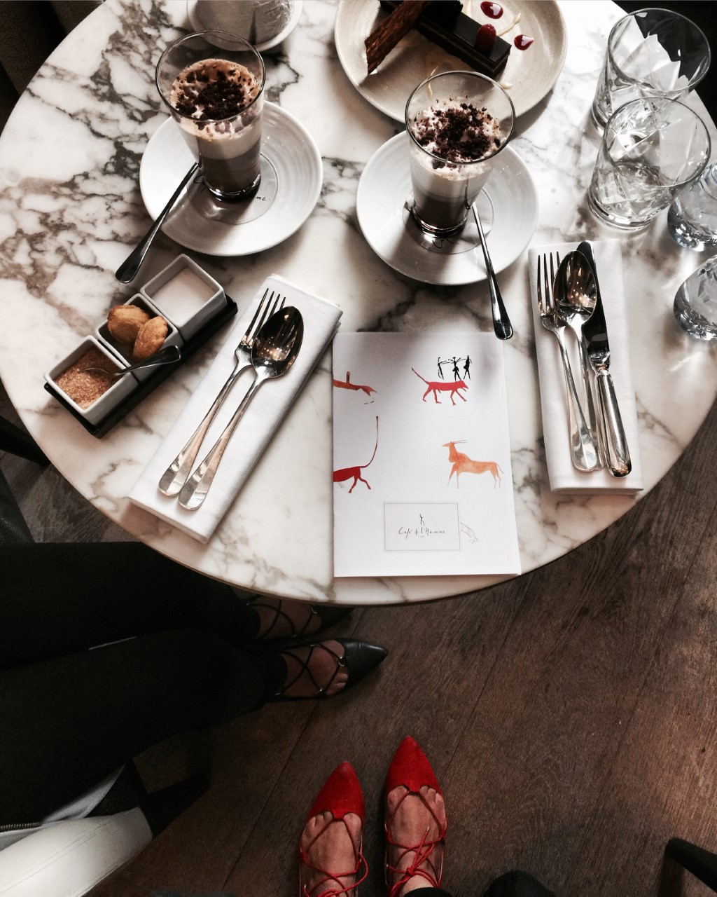 CAFE D L'HOMME - A beautifully decorated art deco cafe with stunning views of Eiffel Tower, while sipping on your latte.