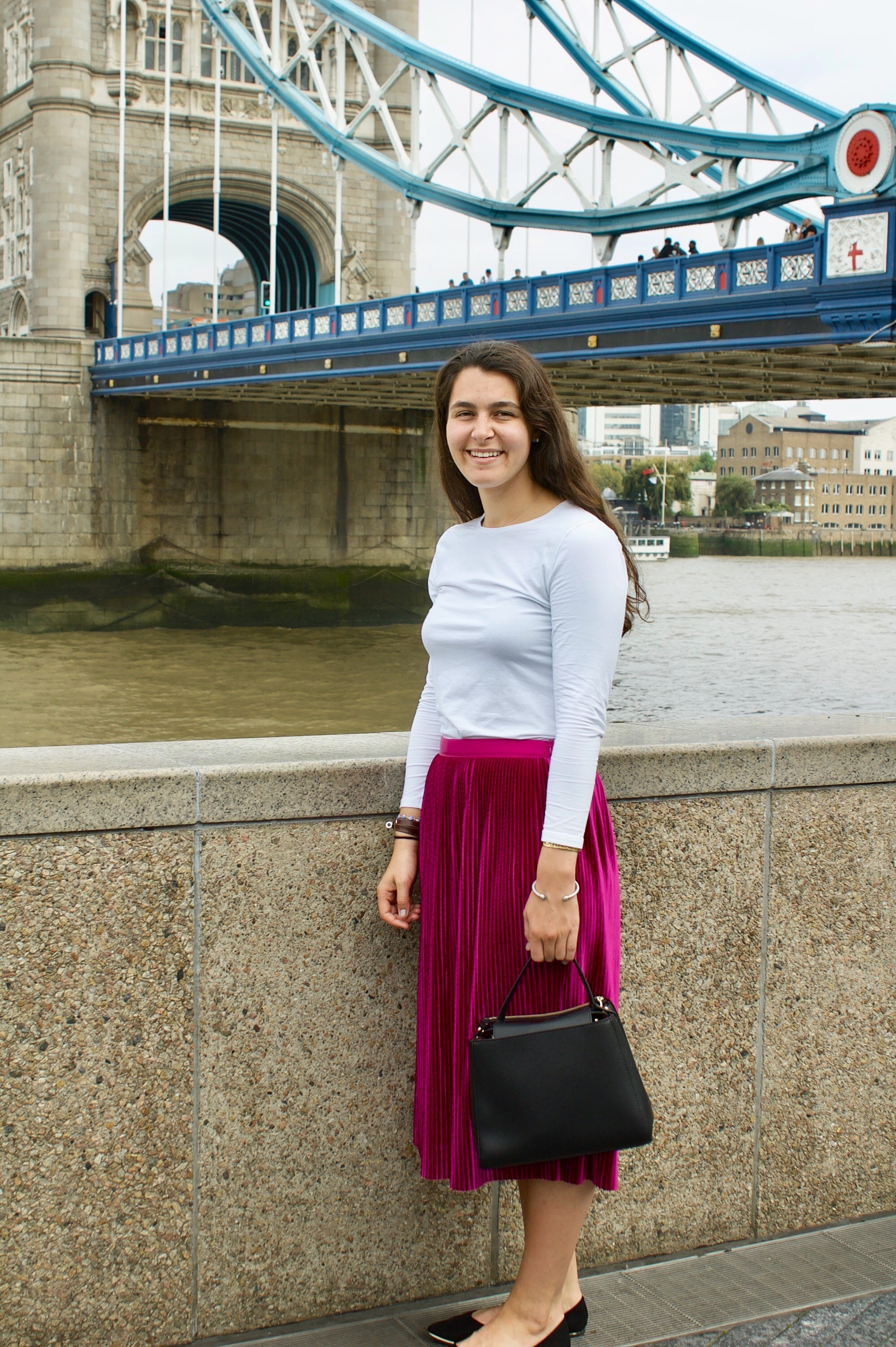 London, UK 10.14.17    My 21st birthday skirt! I was determined to wear something that made me happy, so a pink pleated skirt is what I chose! Shop my favorite pleated skirt look and basic black bags that go with every outfit  here!
