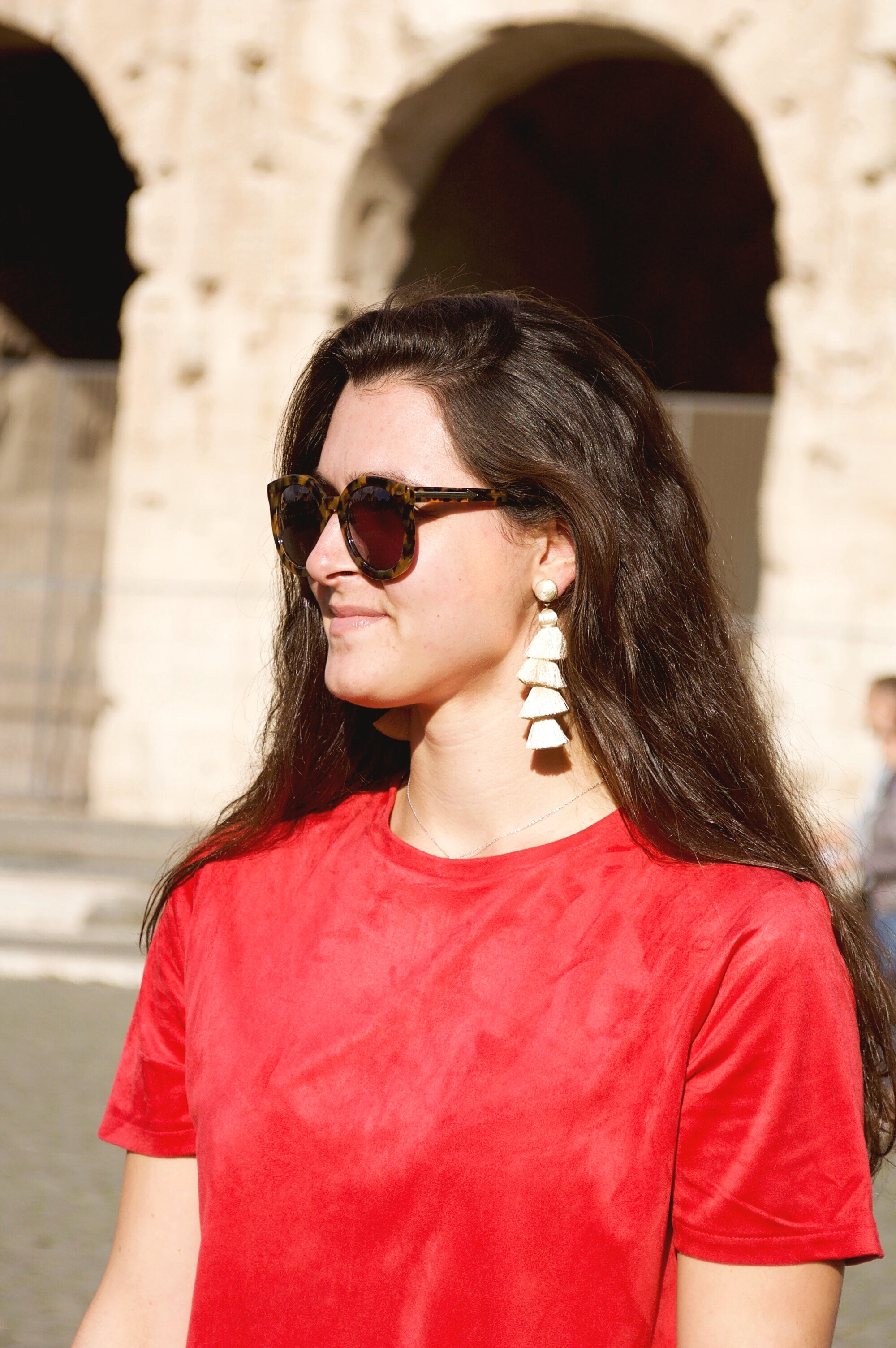 Rome, Italy 11.08.17  Feelin' all the Lizzie McGuire vibes in Rome this week! Whenever I'm in Italy, I feel the need to wear red. Since Christmas is around the corner, I collected my favorite red dresses under $100, as well as my favorite tassel BaubleBar earrings!  Check out my picks here!