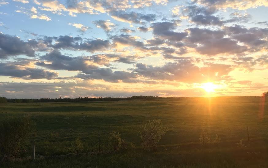 Sun setting west of Pigeon Lake.