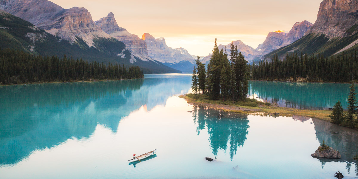 Maligne Lake in Jasper Renee Paddling at sunrise 2 by Michael Matti.jpg