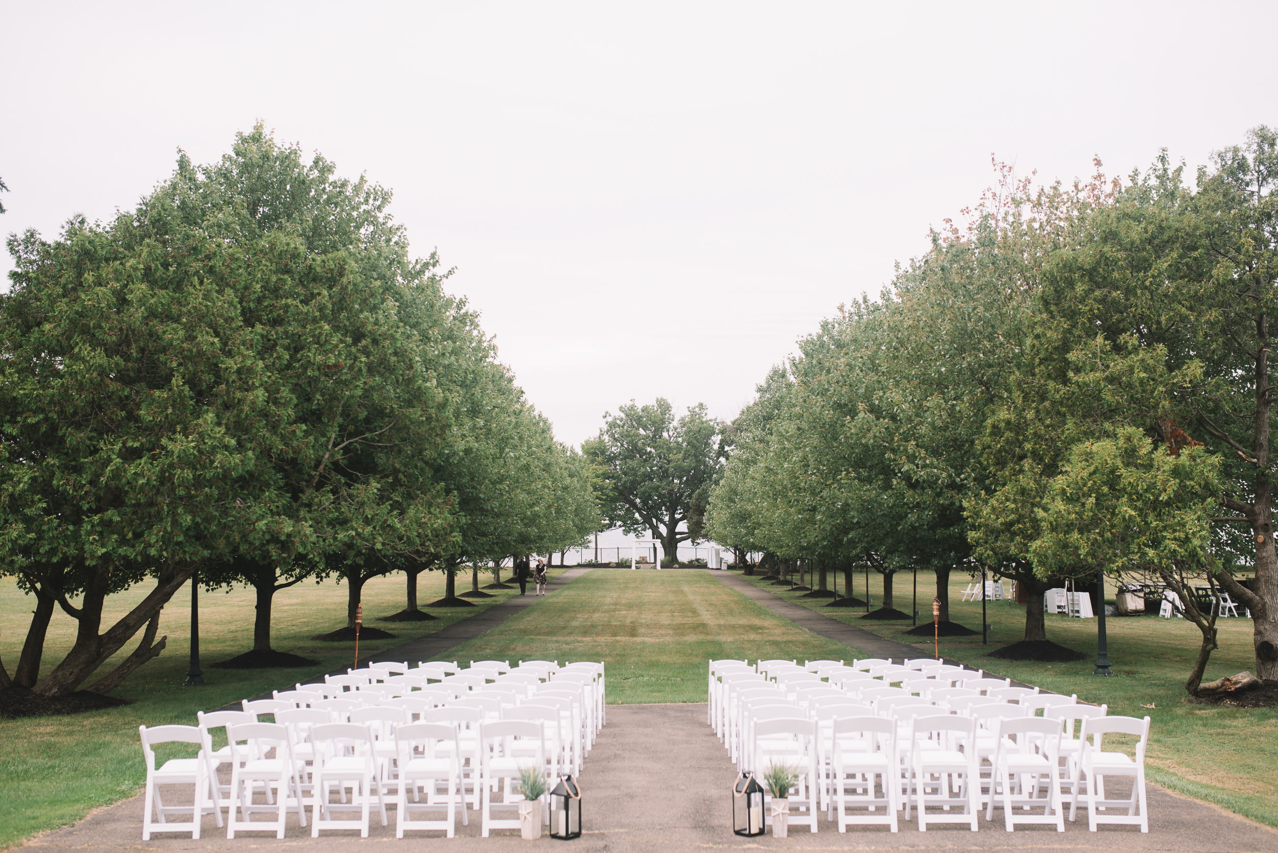 The venue is gorgeously lined with trees, and with the lake in the background, it's a perfect setting for large and small settings alike. It's definitely one of our favorite locations in the Buffalo area for Wedding photos.