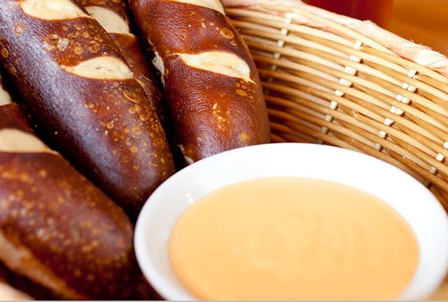 "Come Try Our Pretzels with Our Signature ""Cheese"" Sauce."