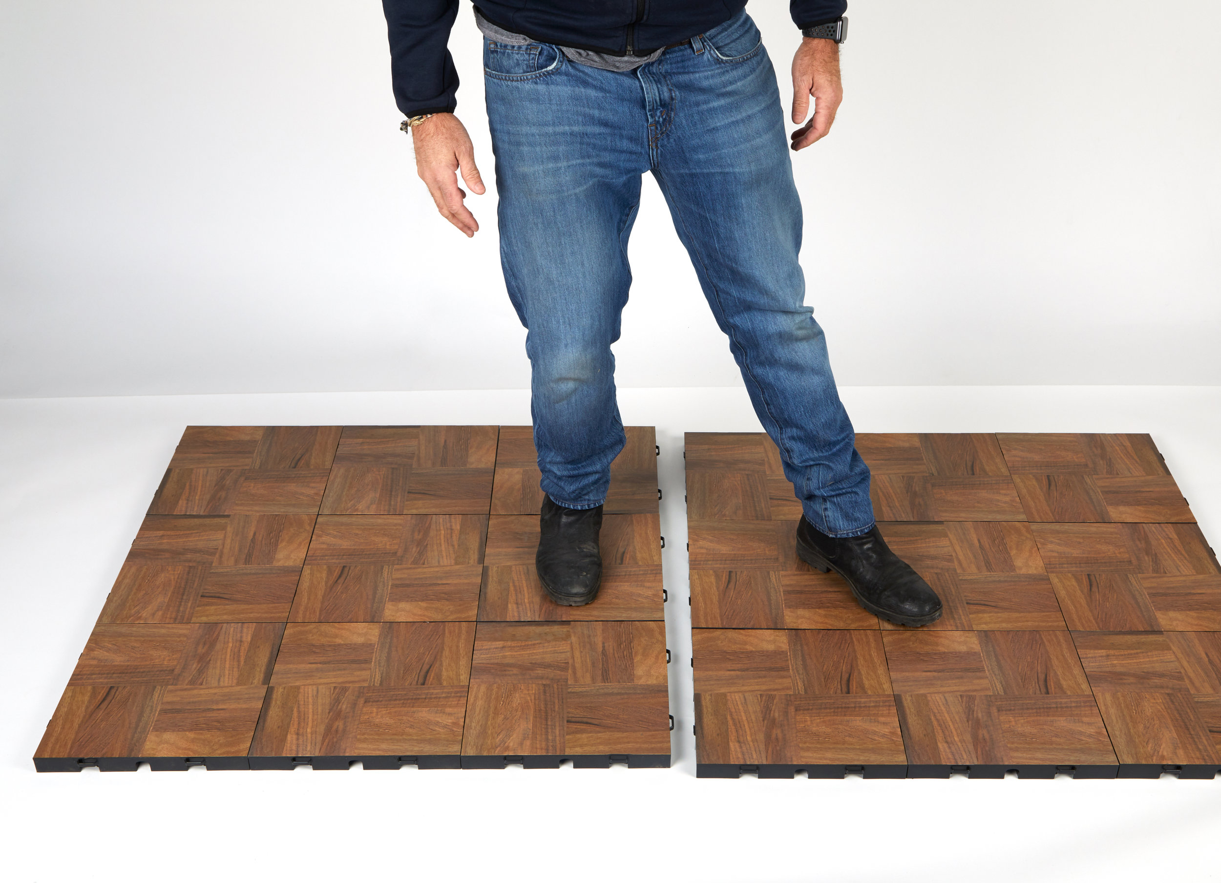 STEP 3:  Use your foot to nudge flooring over to the first panel, such that the male clips ride onto the female loops. Sections are designed to self-align when nudged together.