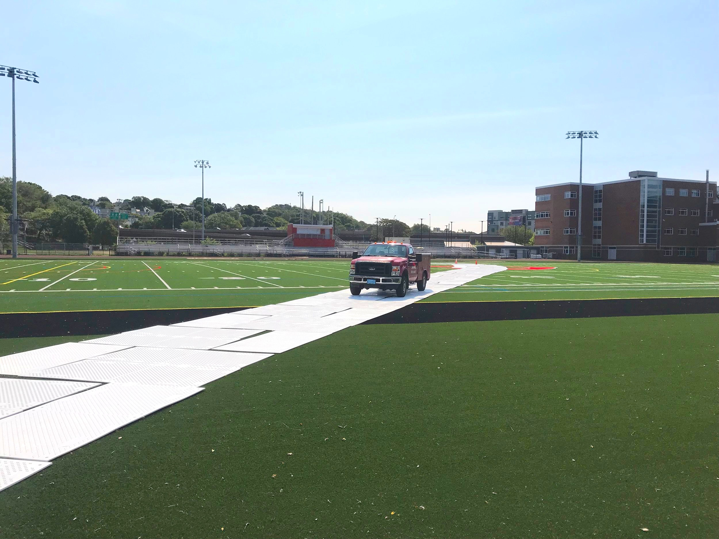 EverRoad is a driveable roadway system for use on soft ground or over natural and synthetic turf