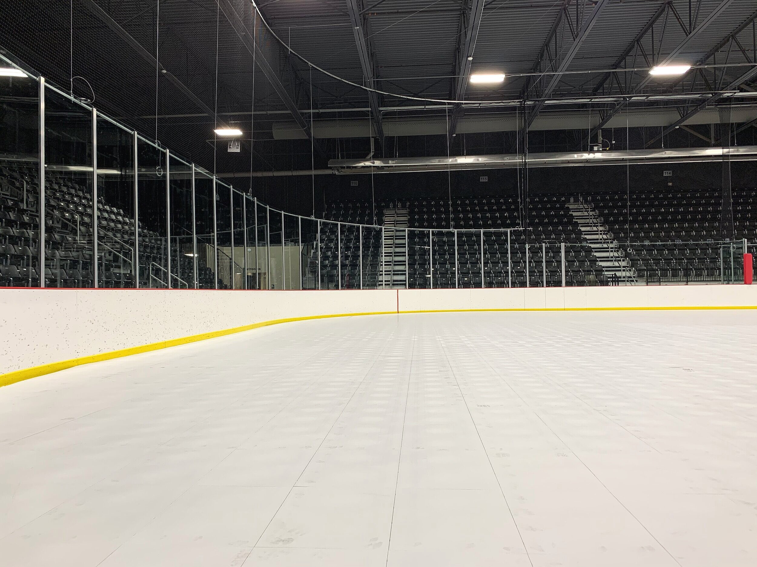 EverBlock's EverBase ice rink flooring sits flush with the dasher-boards.