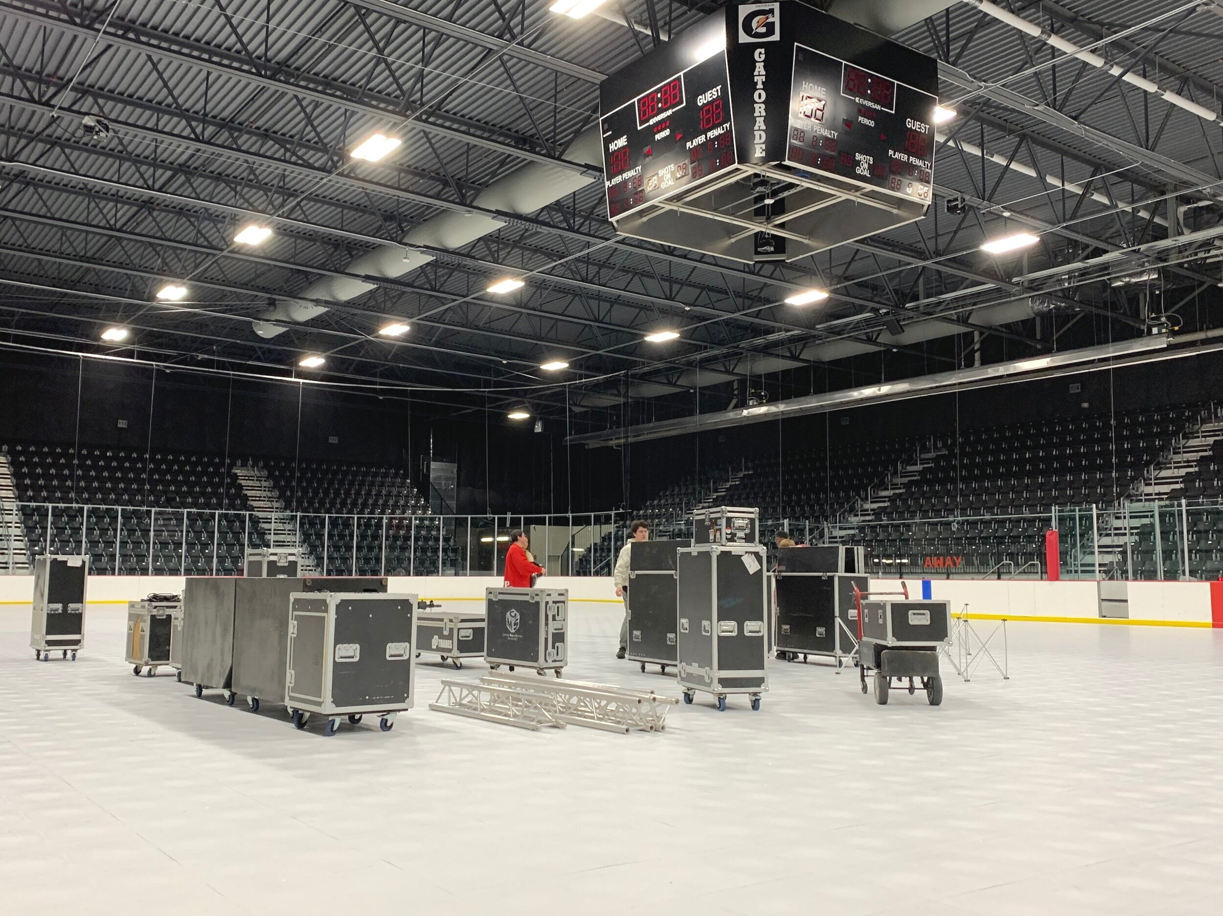 Move rolling cases and equipment on the arena floor.