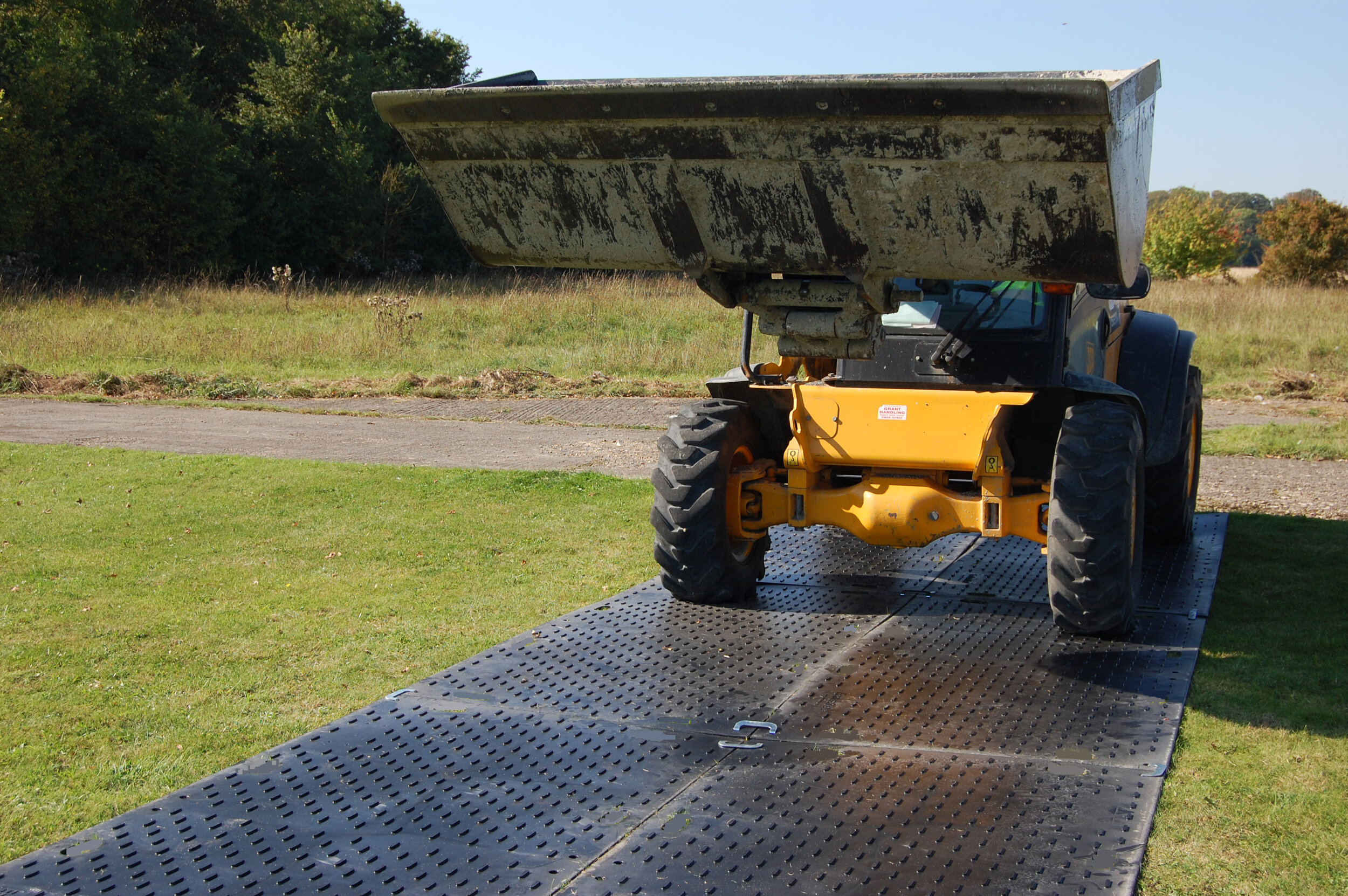 Provide support for heavy equipment and moving loads by creating a trackway using EverRoad Access Mats