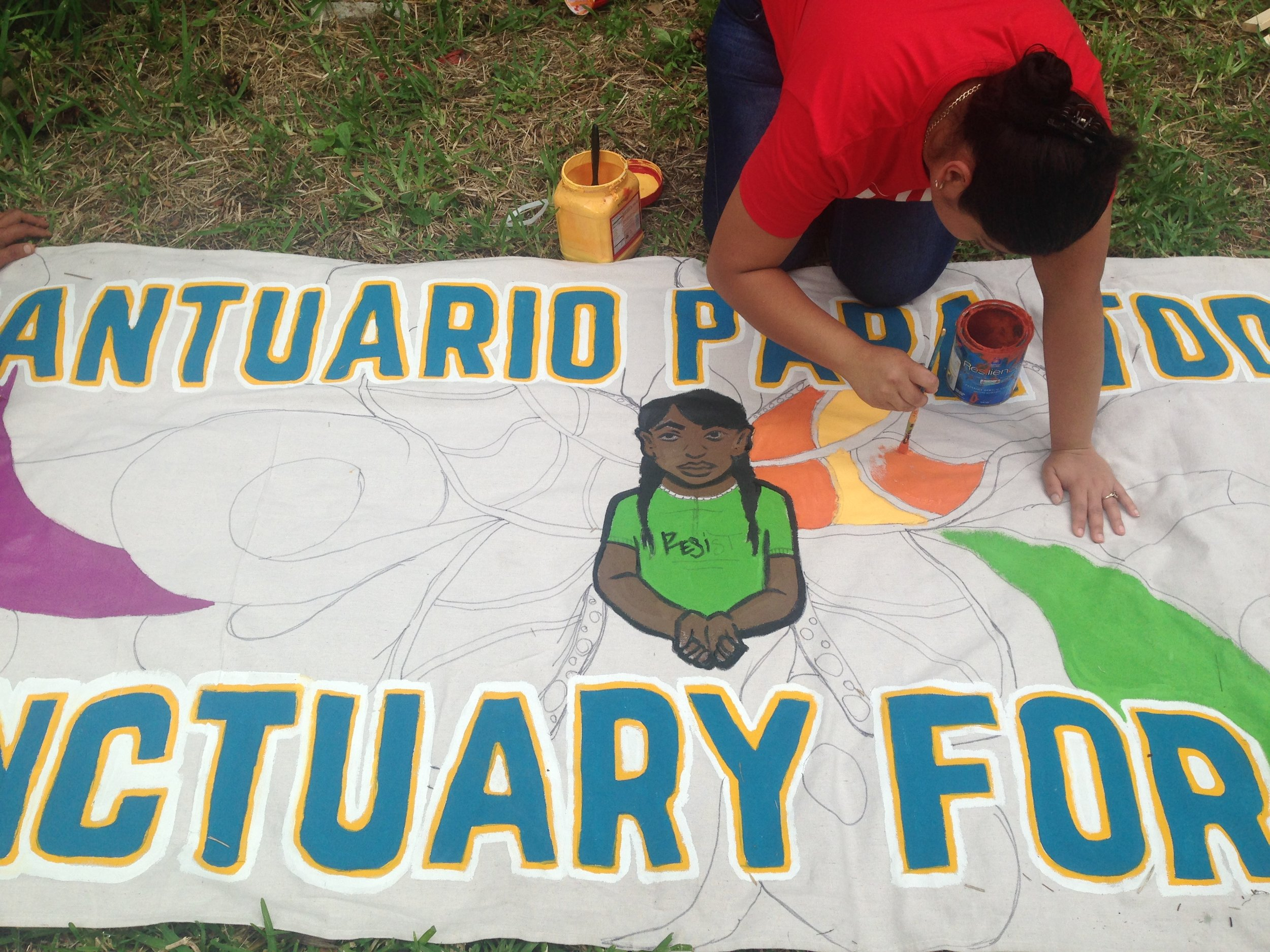 Collaborative banner making…in action! With the  New Orleans Workers' Center for Racial Justice  and  Congreso de Jornaleros (Congress of Day Laborers) . Photo by Karla Rosas.