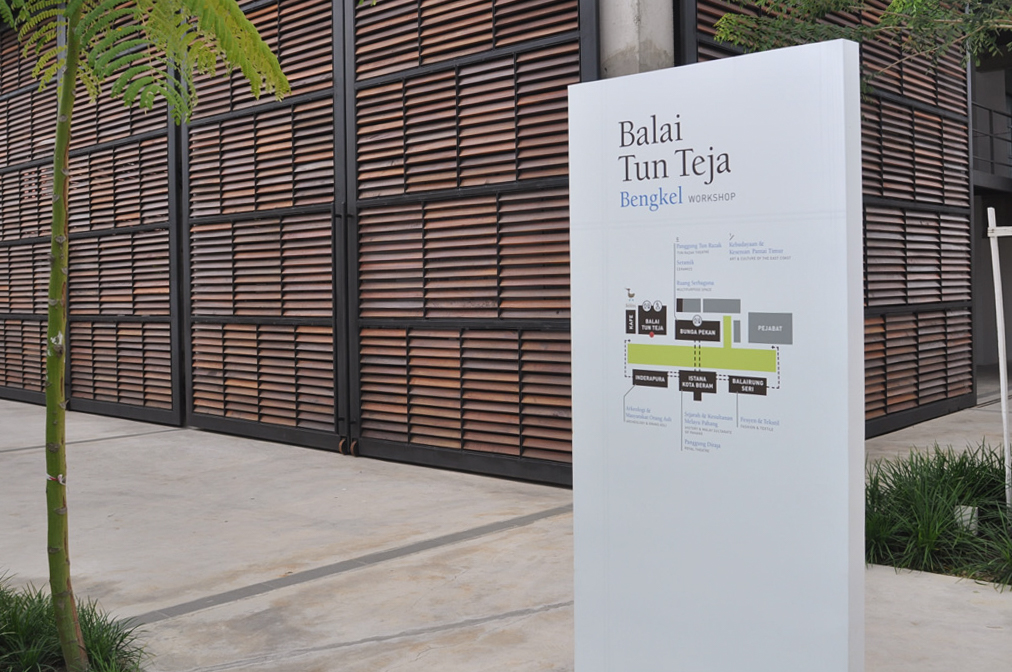 The directory stands in front of the new workshop building. The building opens fully on three sides.