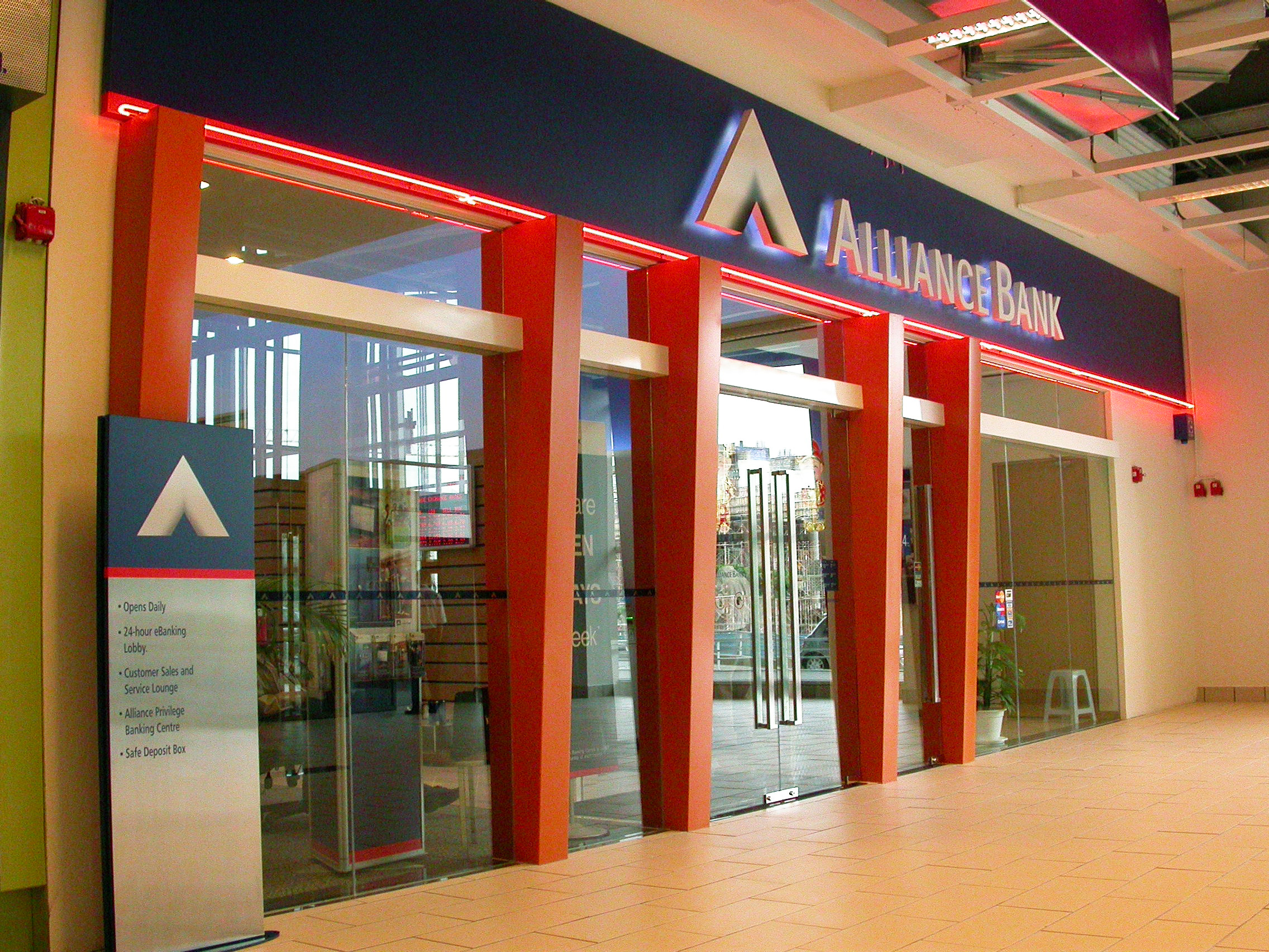 All offices and retail branches of the seven financial institutions throughout the country had to undergo a quick overhaul, and the easiest and most economical means of establishing its new identity across all physical locations was to paint some part of the fa ç ade in the bank's signature red.