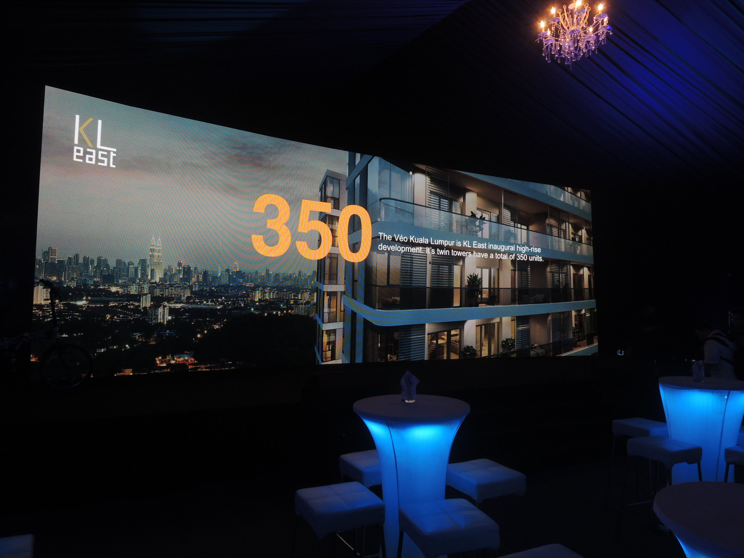 Large-screen video presentation at KL East's launch.