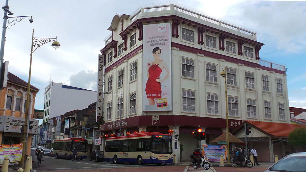 Photo taken in 2014 . After weeks of painstaking work to restore the beautiful traditional 3-dimensional signboard on the Eu Yang Sang building in Georgetown (by Khoo Salma and team), the entire sign was covered by a plastic tarpaulin advertisement. Although Eu Yang Sang, a pharmaceutical conglomerate, had every right to do this as both building and signboard belonged to the company, it was a foretaste of things to come for Georgetown.