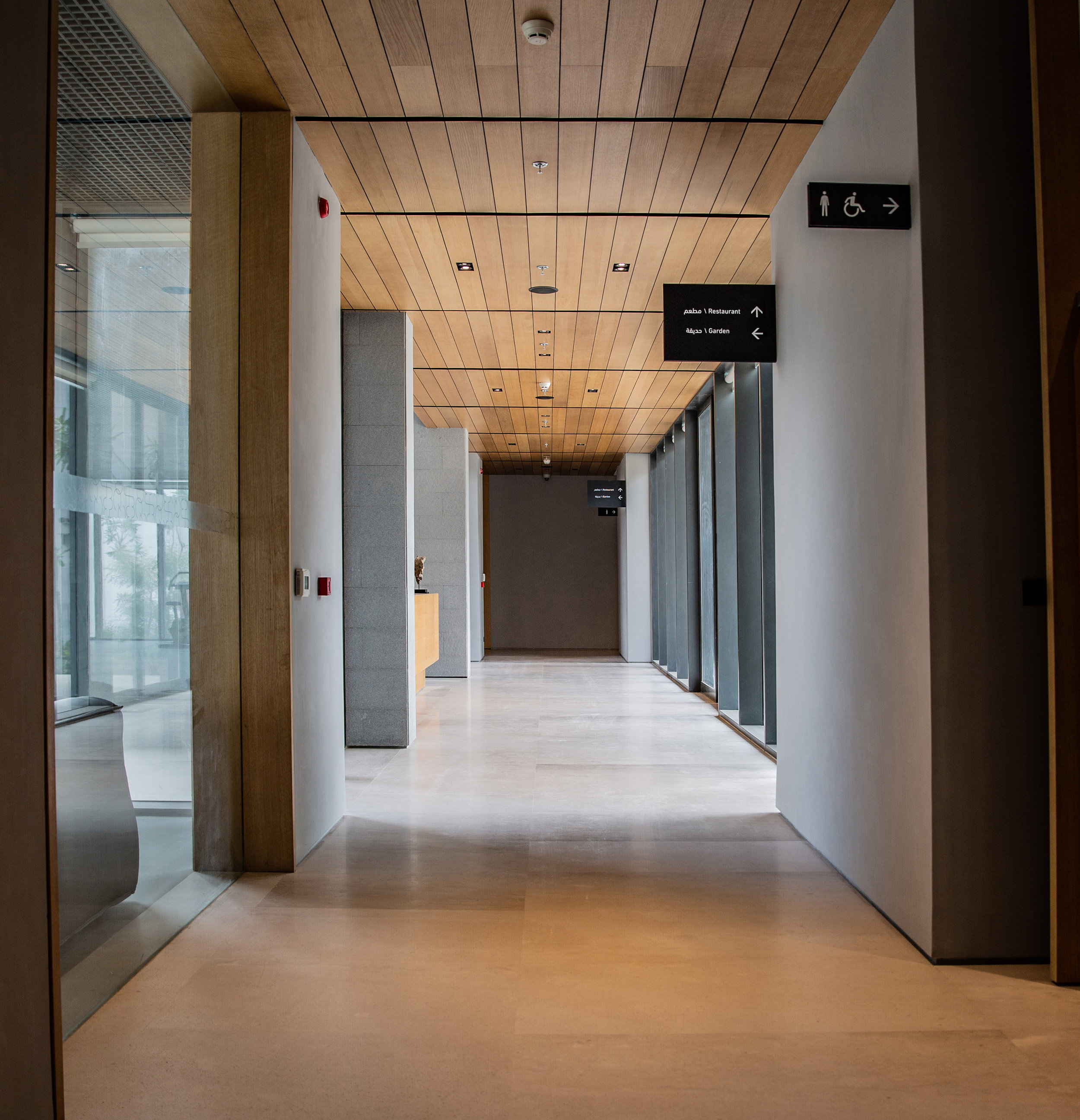 Interior signs mirror the austere rectangular forms of the architecture