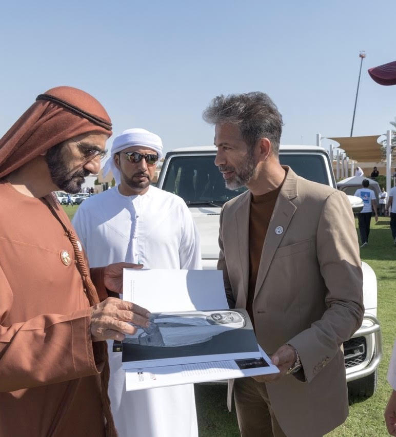 Neel Shukla, Ramesh's son, presenting the first book to His Highness, Sheikh Mohammed.