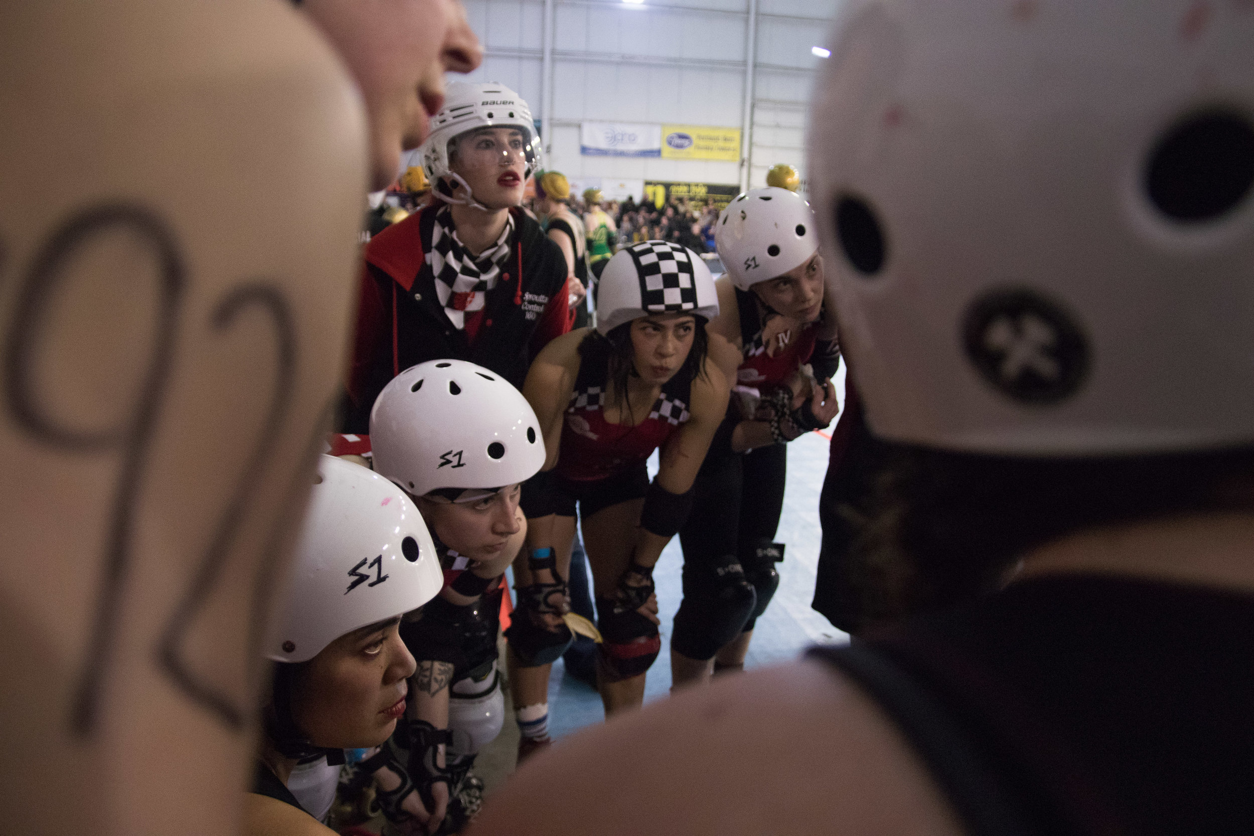 Break Neck Betties huddle at halftime during a game against the High Rollers on April 8, 2017.When not competing, practicing, or cross-training together, the Betties are a close-knit crew. They choose to spend much of their free time together socializing and supporting each other in non-derby activities.