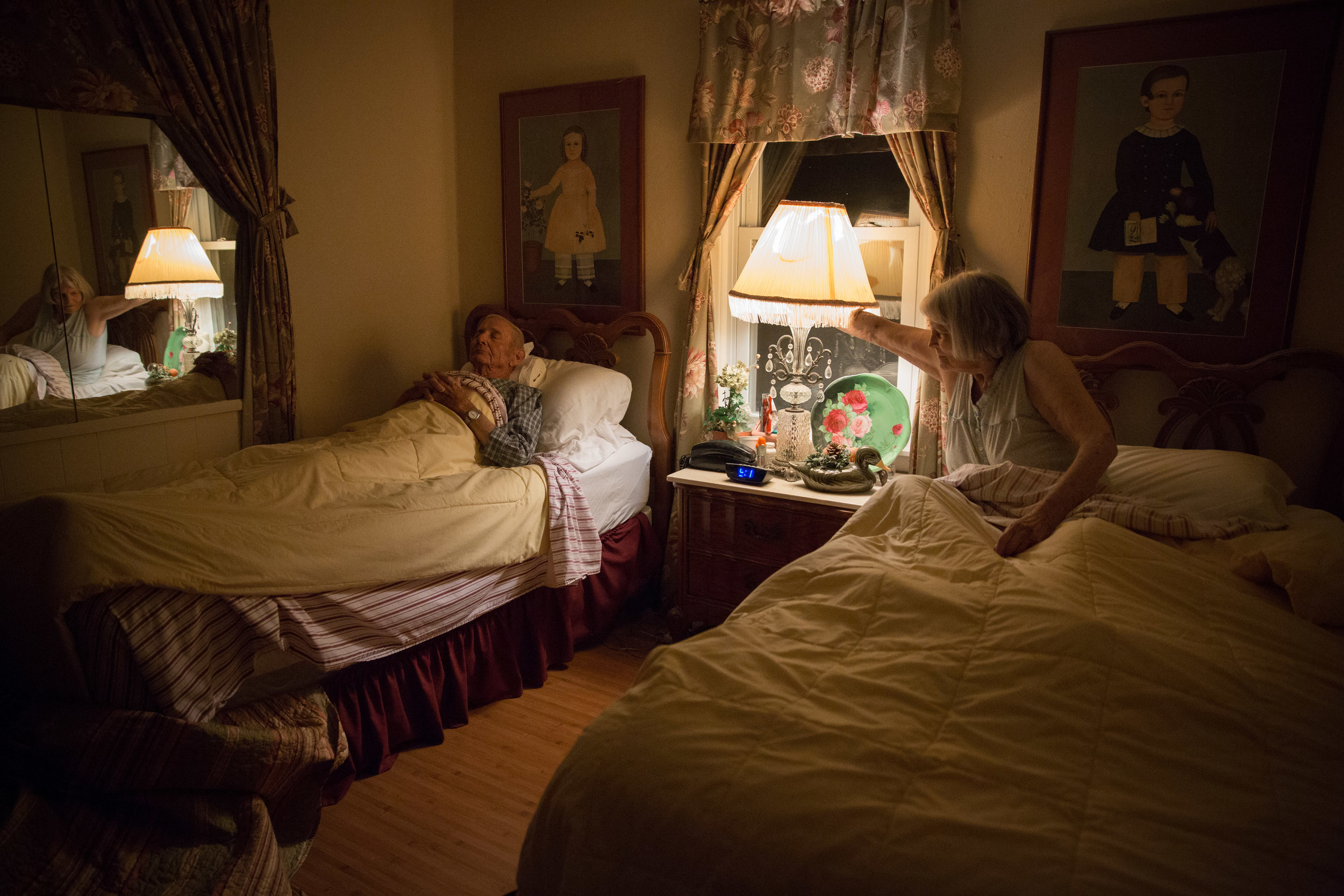 Around 9 p.m. Ruth tucks Carl into bed before getting into her bed and turning out the light.
