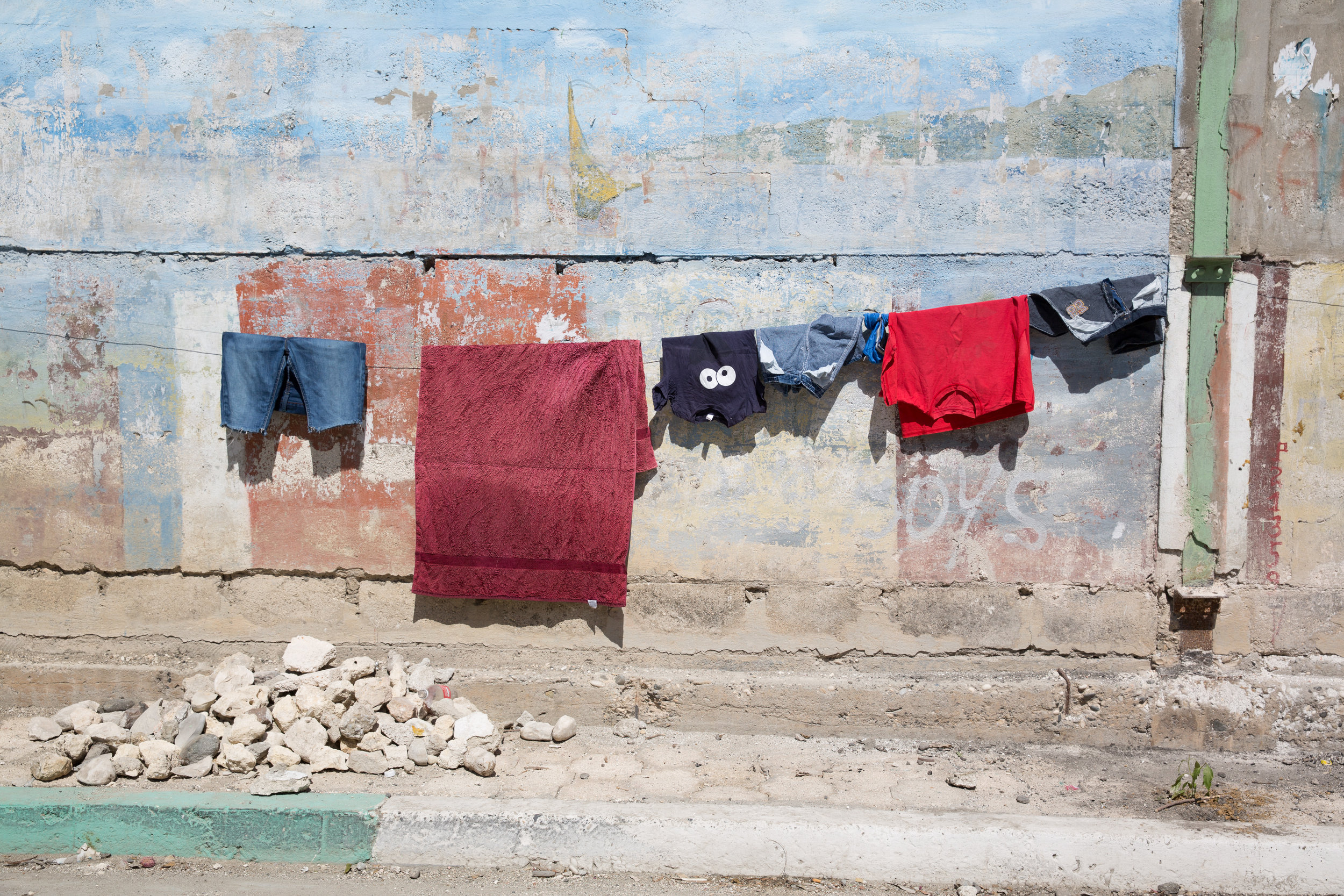 Laundry hangs along Rue Du Commerce in Jacmel, Haiti, on Feb. 4, 2018. Without washing machines, washing clothes by hand at the river or at home is a regular chore for many Haitian women and girls.