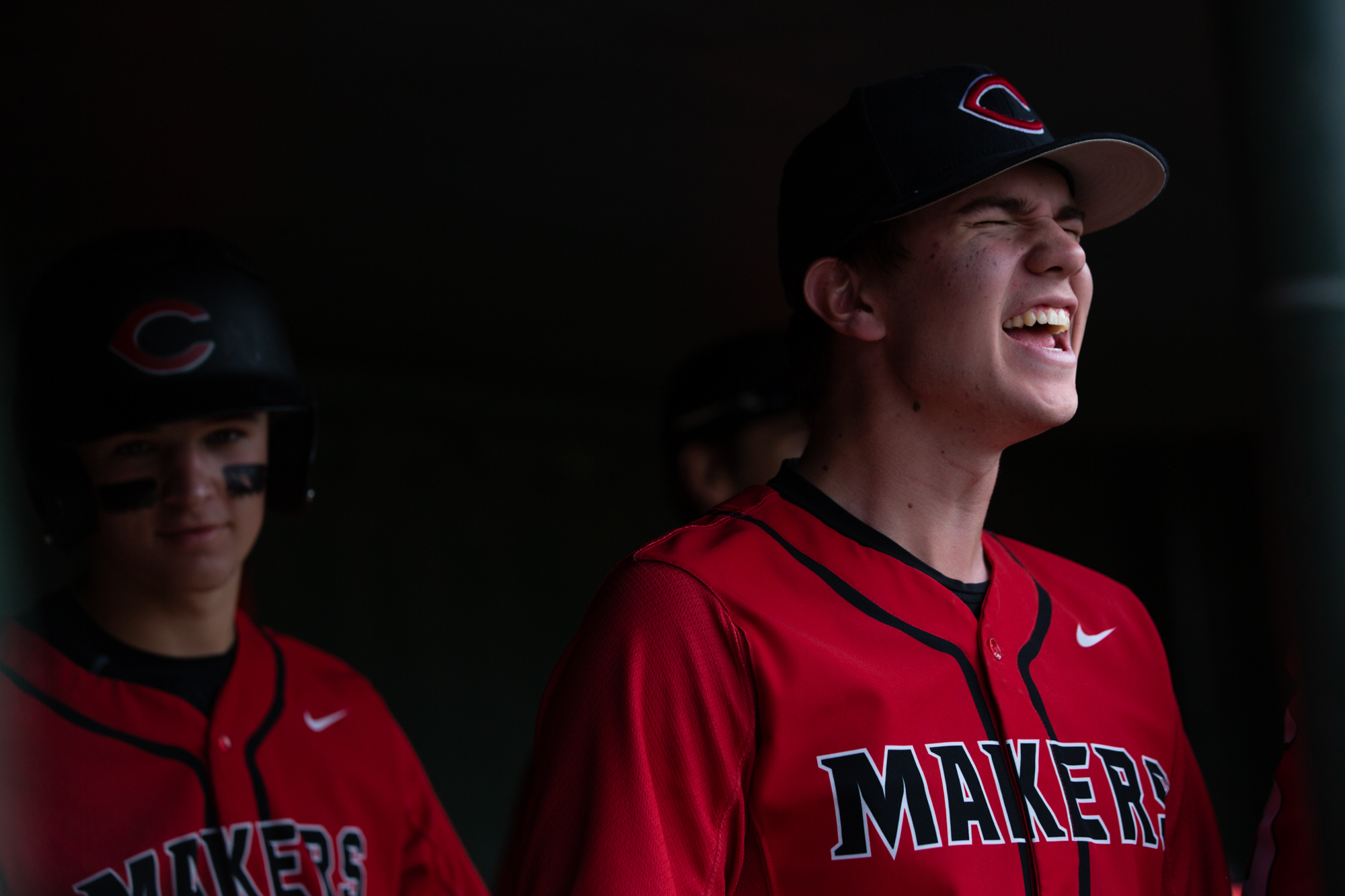 Luke Brewer of the Camas Papermakers cheers on his teammates from the dugout during a game against the Issaquah Eagles at Propstra Stadium on Saturday afternoon, May 18, 2019.