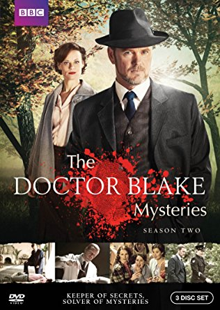 The Doctor Blake Mysteries Season Two - 201310 x 60 minDrama seriesDecember Media/ABC TV AustraliaHaving returned from Singapore after being reunited with his daughter, Doctor Lucien Blake arrives back in Ballarat only to be faced with some of the most challenging crimes he's ever had to unravel.Throughout the series, Blake is swiftly drawn into the world of rock and roll, local politics, the arts and the Catholic Church, among others. Blake is as cunning as ever as he cleverly untangles crimes to get to the truth. Again, nothing is sacred and no-one is safe.