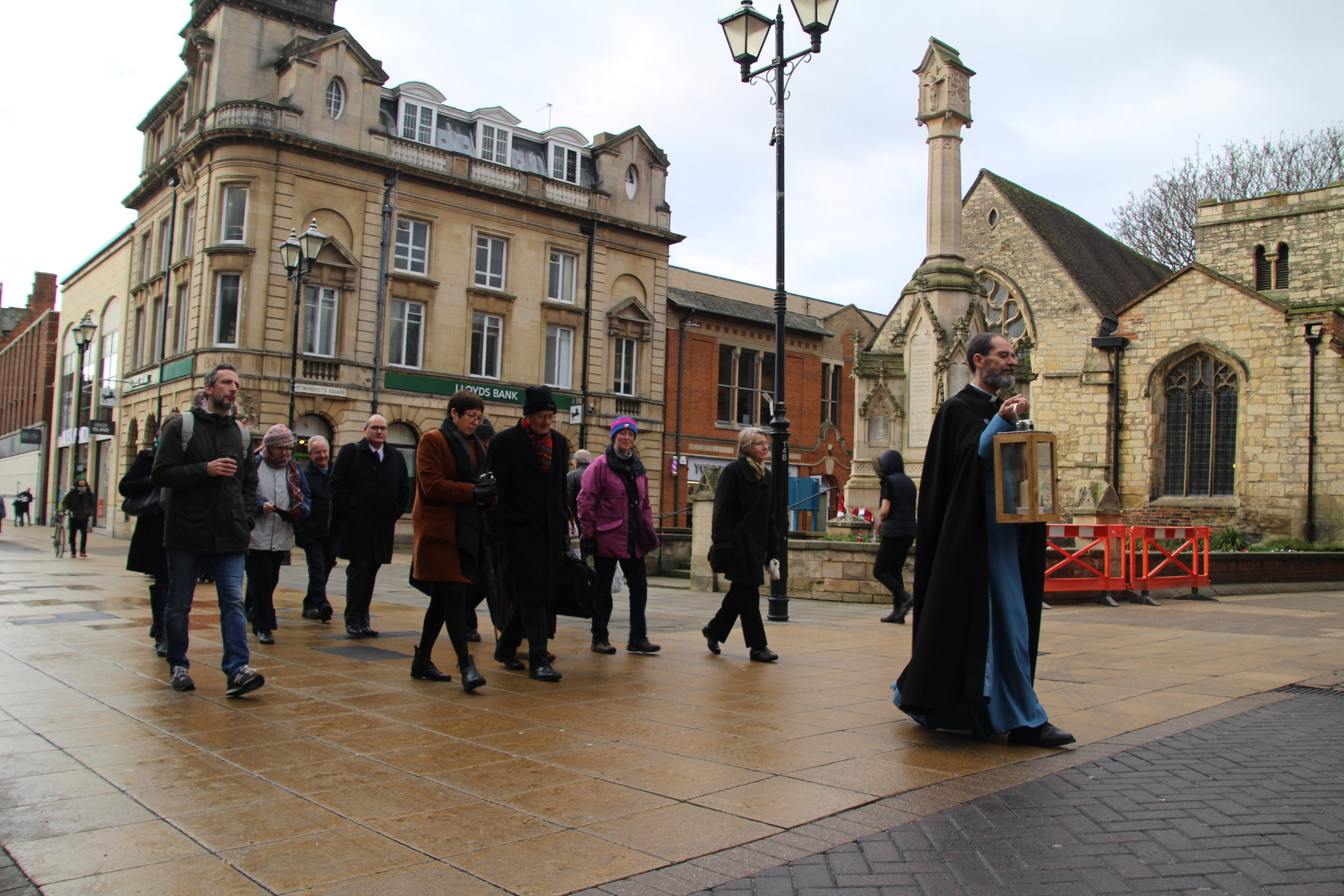 Revd Dr Paul Overend leads a prayer walk through Lincoln to the Cathedral.