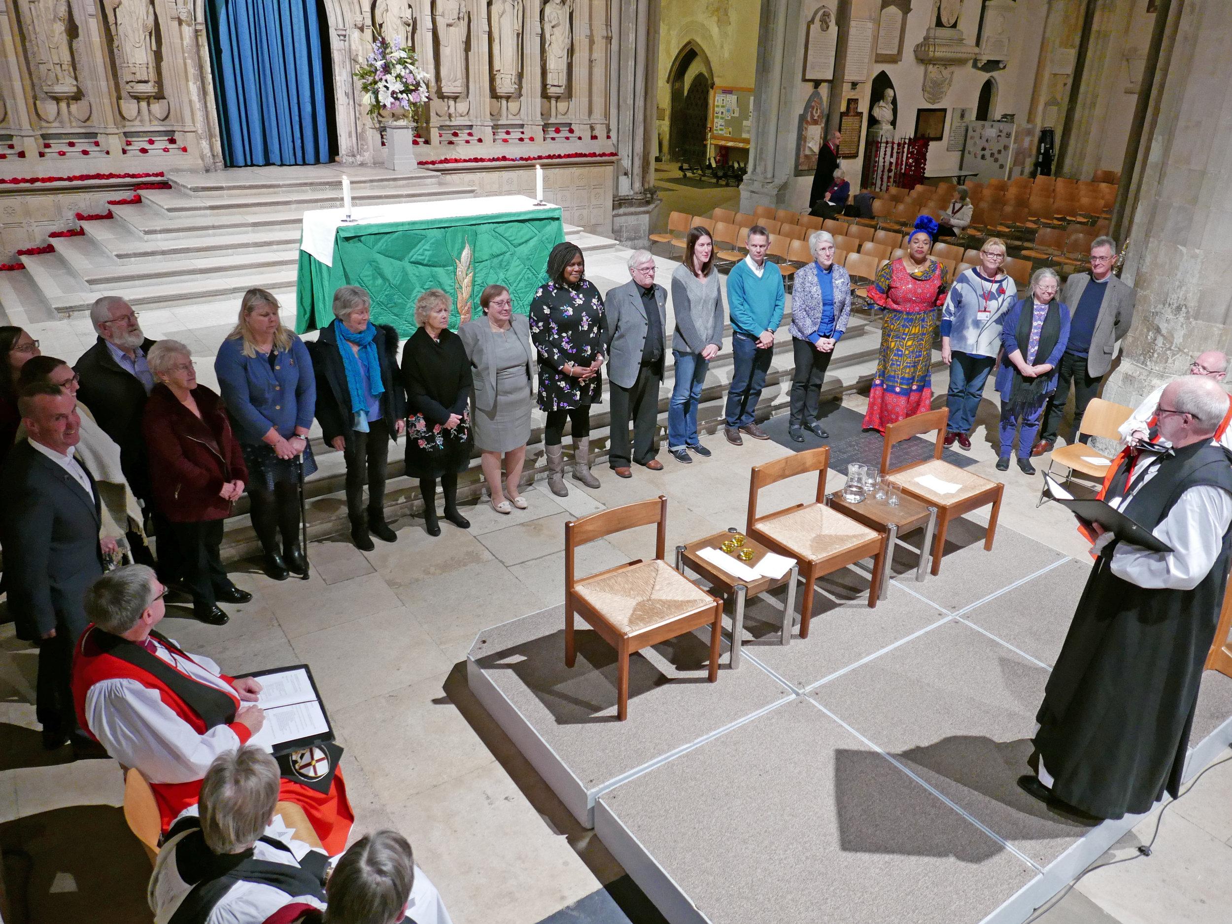 Archbishop Juston commissions the volunteers