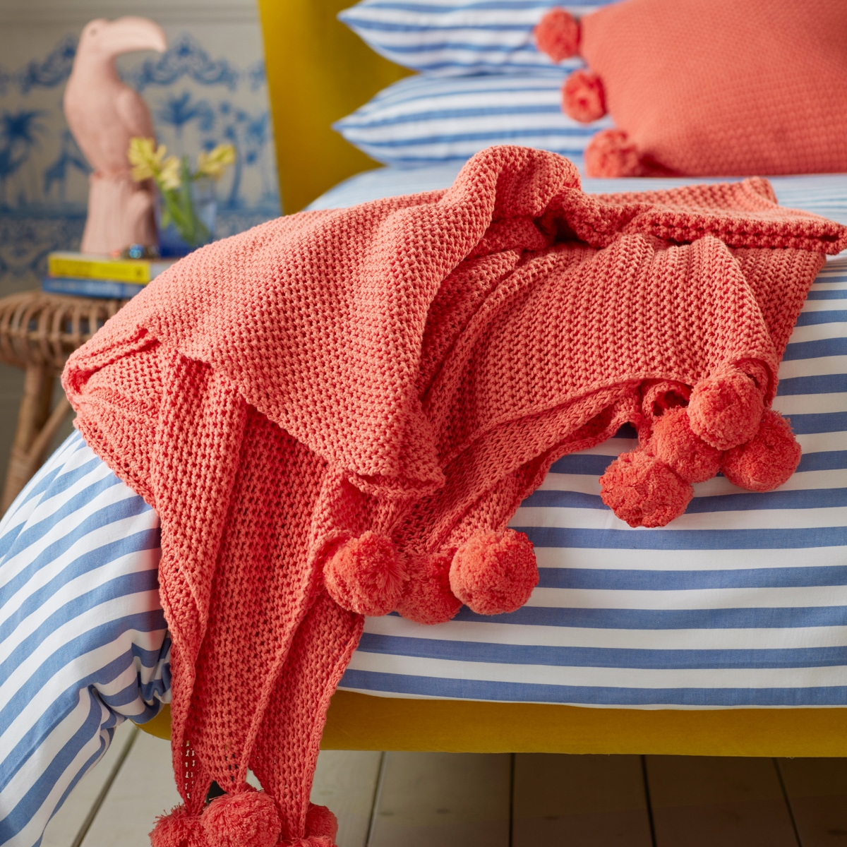 Secret-Linen-Store-Hot-Coral-pompom-throw-£95-1600x1200px-crop-1200x1200.jpg