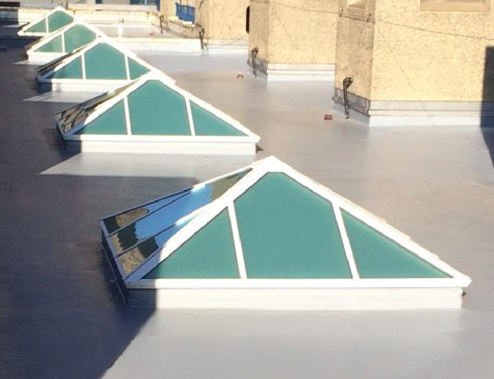 Images ⇢    Works: Liquid urethane and roof lights.   Job Details:  Existing mastic asphalt roof overlaid with liquid urethane system.Rooflights removed and replaced. Renewal of mastic joints. Sealing of redundant smoke vents.