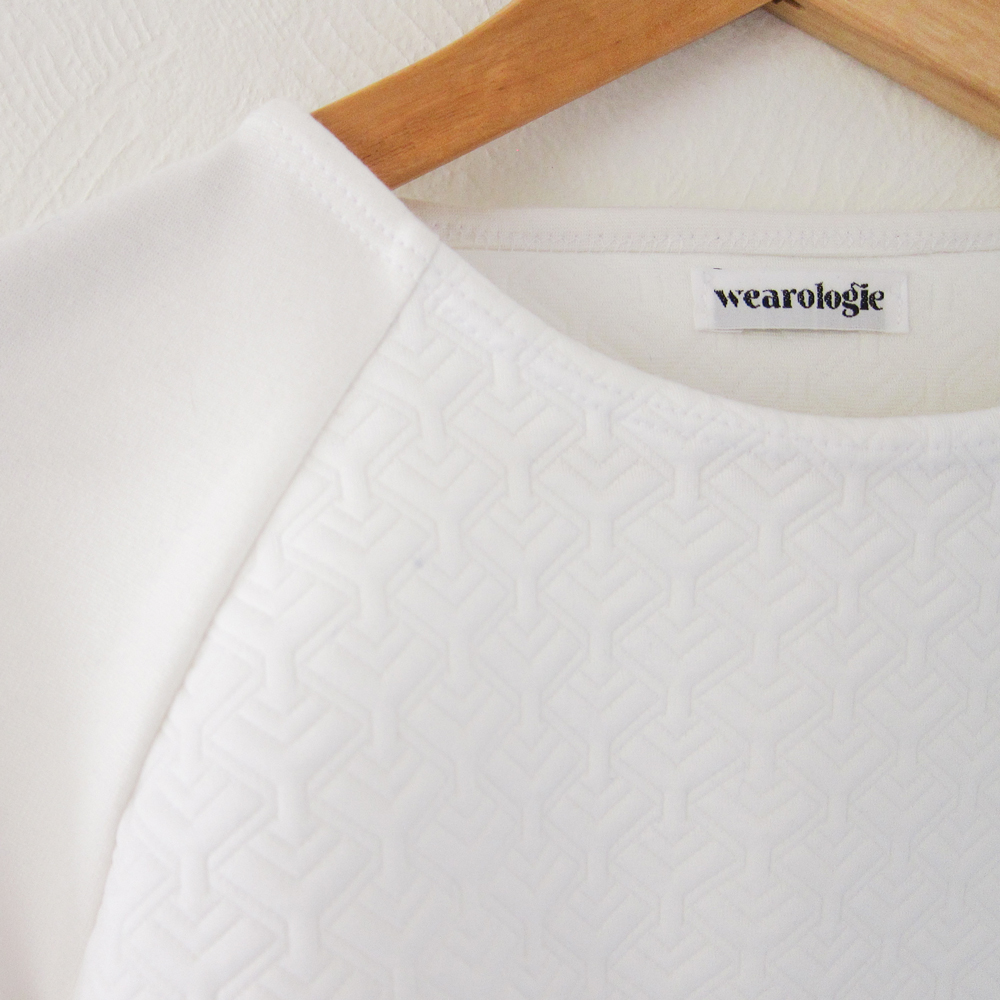 Stunningly finish a neckline when sewing with stretch fabrics with our clean finish binding method — By Wearologie.com