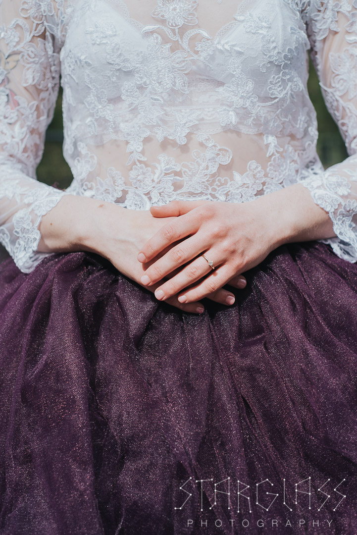 Photo of a bride in a purple wedding dress.