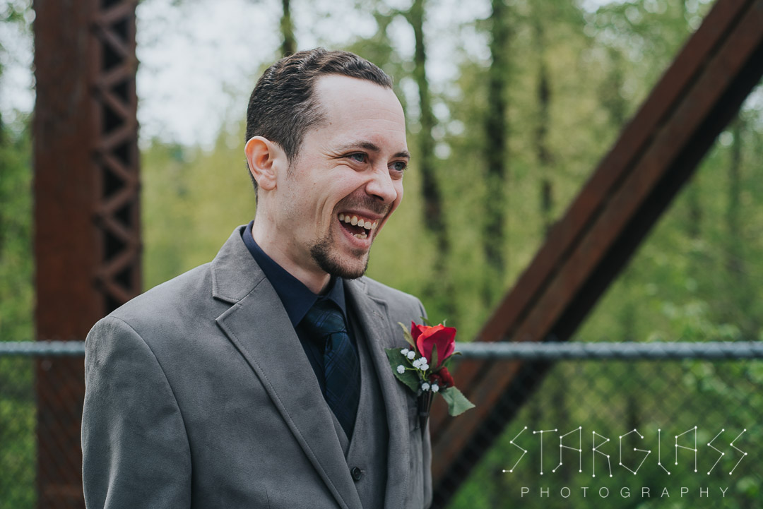 Groom's reaction to the bride during their first look.
