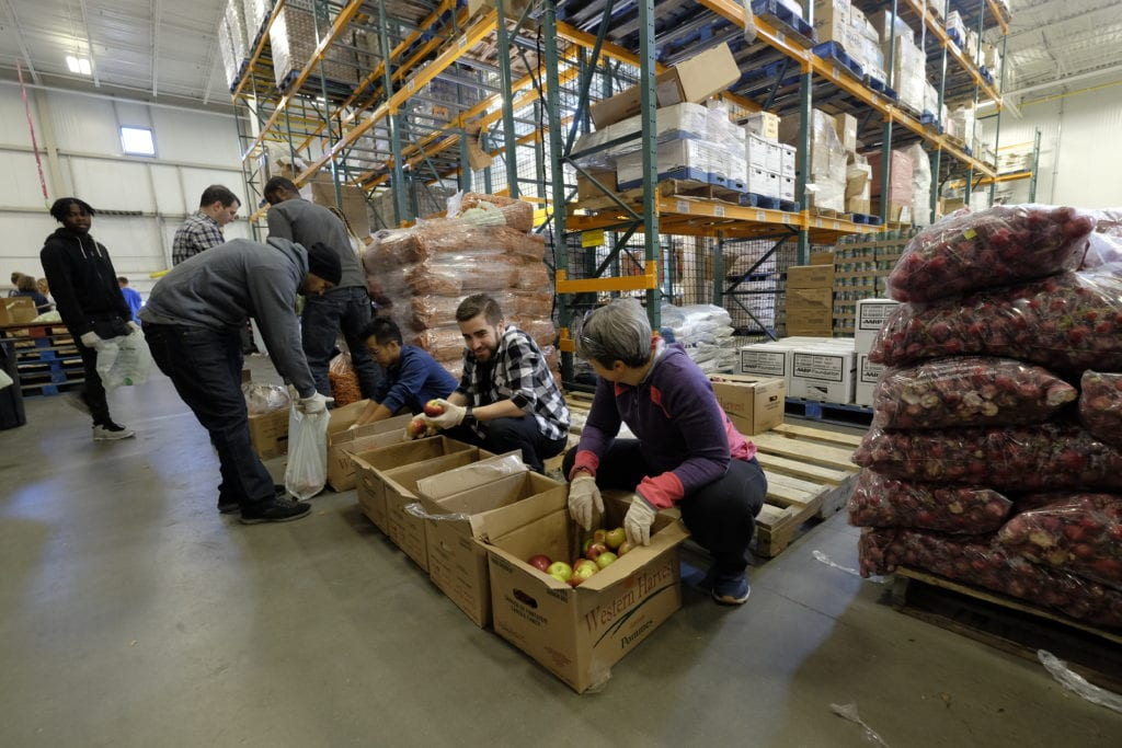 In January 2019, volunteers sorted produce the Capital Area Food Bank provided to furloughed federal workers and contractors at popup markets around the region during the government shutdown. Photo provided by the Capital Area Food Bank.