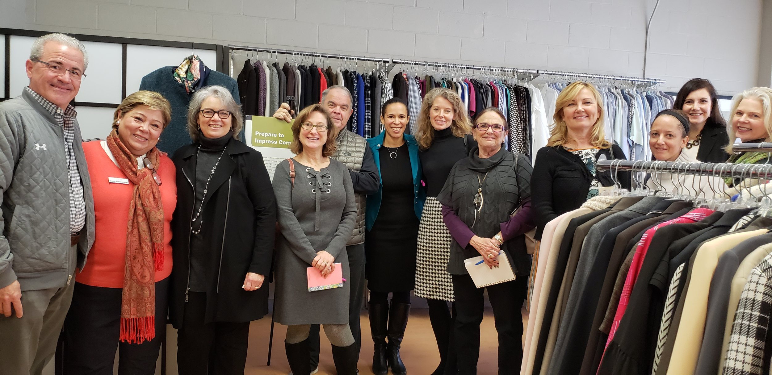 Bobbi Shulman (the fifth person on the right side of this photo) and other members of the Sharing Montgomery Committee visit Interfaith Works, another nonprofit in Montgomery County.