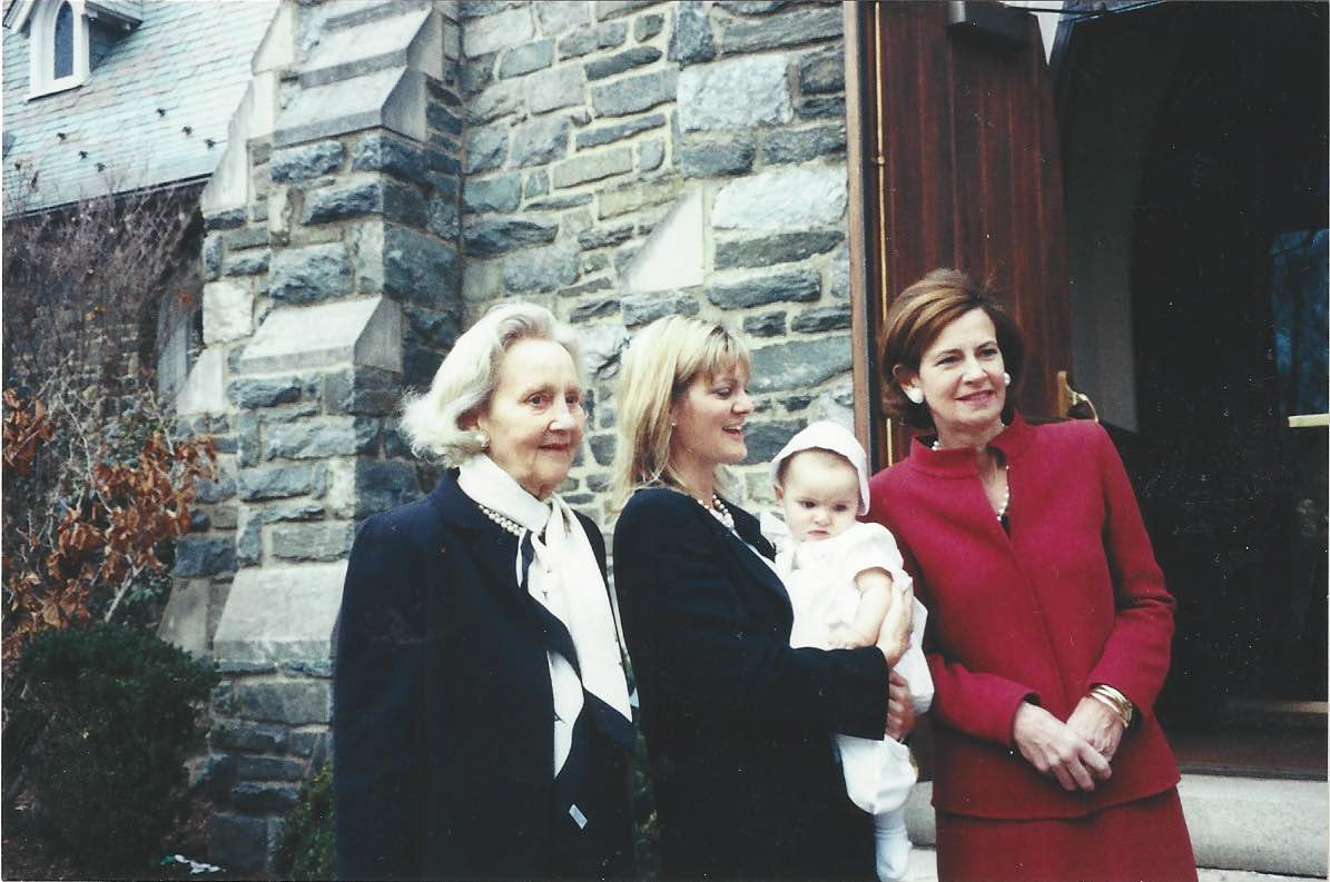 Katharine Weymouth (center), with her grandmother Katharine Graham (left), daughter (in Weymouth's arms), and her mother Lally Weymouth (right) at the National Cathedral.