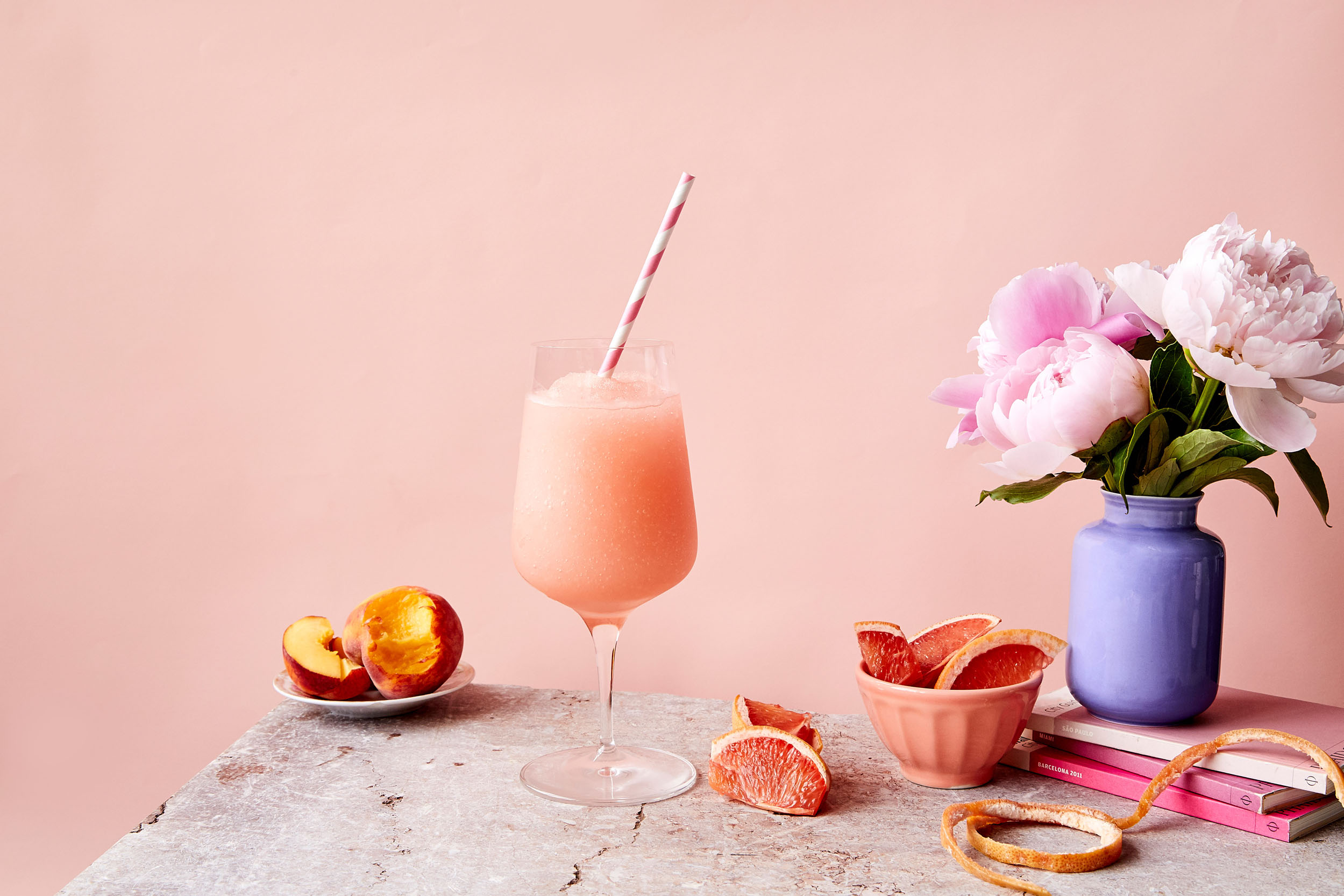 Frozen Frosé Cocktail On Table With Fresh Fruit And Flowers