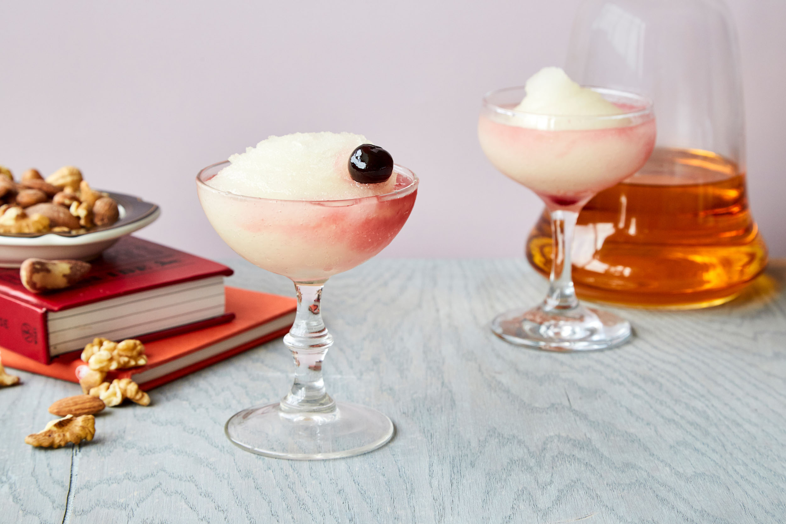 Hemingway daiquiri in a glass with a cherry.