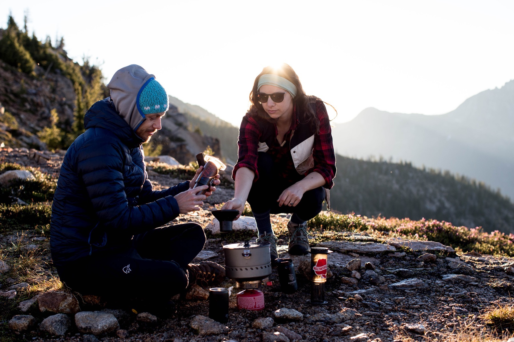 Travel coffee kit essentials. Making coffee during sunrise on a backpacking trip in summer.Photo by Brooke Fitts